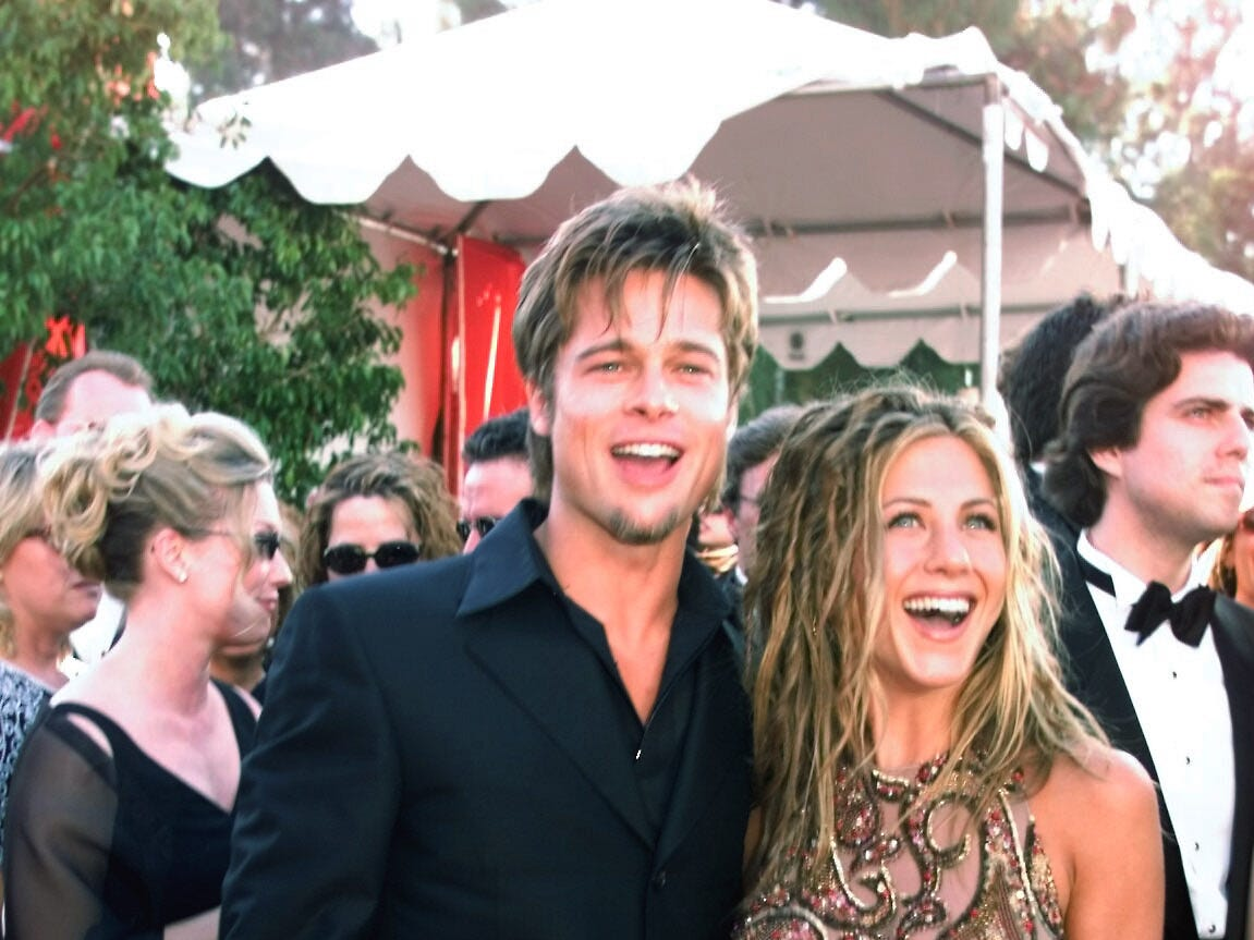 Brad Pitt and Jennifer Aniston  laugh with the photographers as they arrive at the 51st Annual Emmy Awards