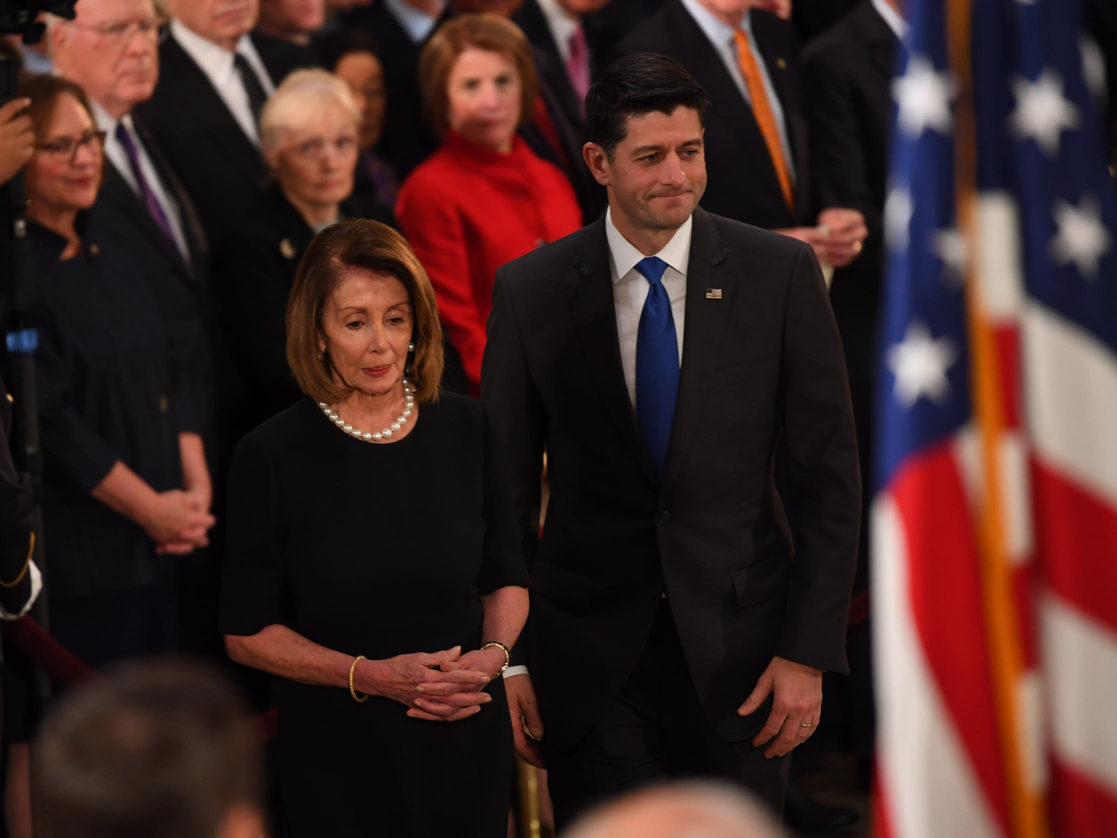 U.S. House Minority Leader Rep. Nancy Pelosi (D-CA) and Speaker of the House Rep. Paul Ryan (R-WI) pay their respects to former President George H.W. Bush, on Monday. The late president will lie in state until 7 a.m. Wednesday, Dec. 5, 2018.
