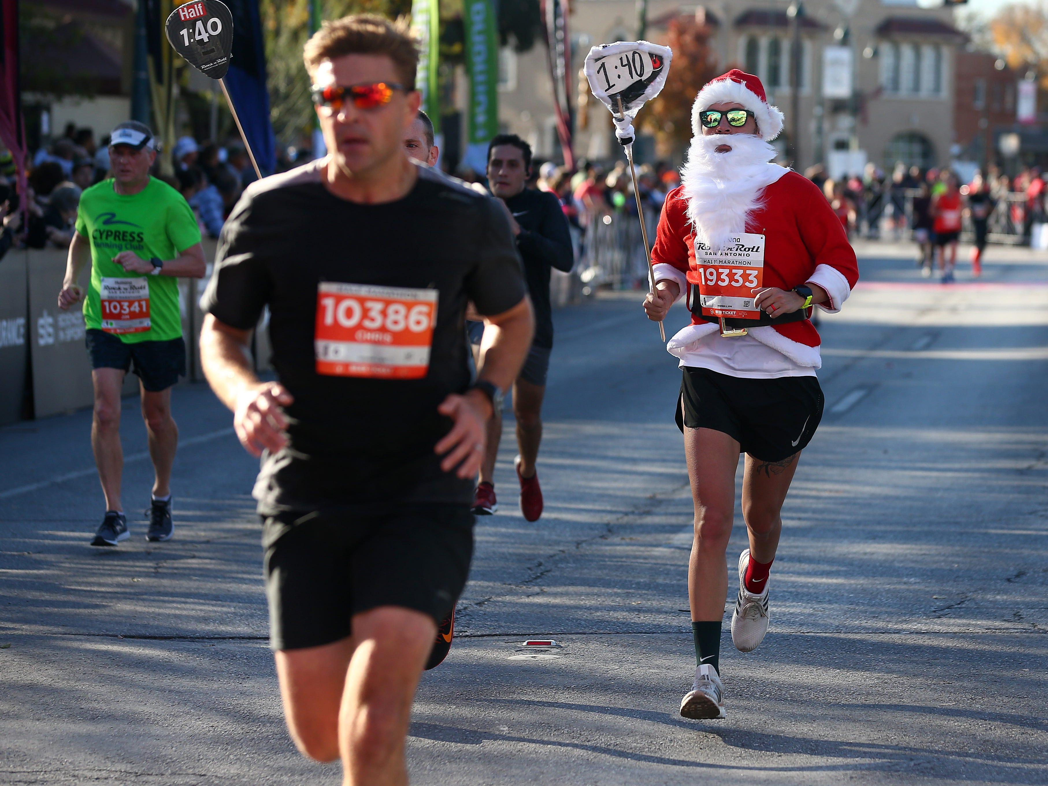 A participant dressed as Santa Claus runs during the Humana Rock 'n' Roll San Antonio Marathon & 1/2 Marathon on Dec. 02, 2018, in San Antonio, Texas.