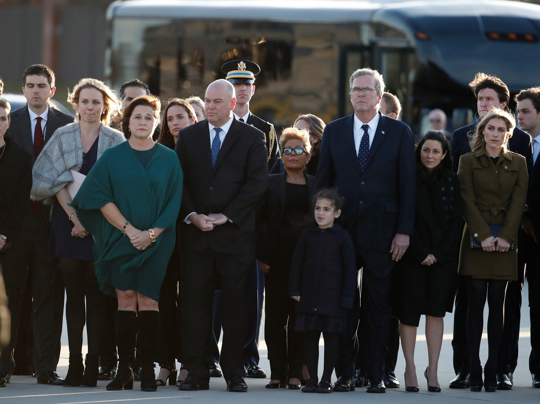 Family members watch as the flag-draped casket of former President George H.W. Bush is carried by a joint services military honor guard at Joint Base Andrews. Bush will lie in state in the Capitol Rotunda before his state funeral at the Washington National Cathedral. George H.W. Bush, the 41st President of the United States (1989-1993), died at the age of 94 on 30 Nov. 2018, at his home in Texas.