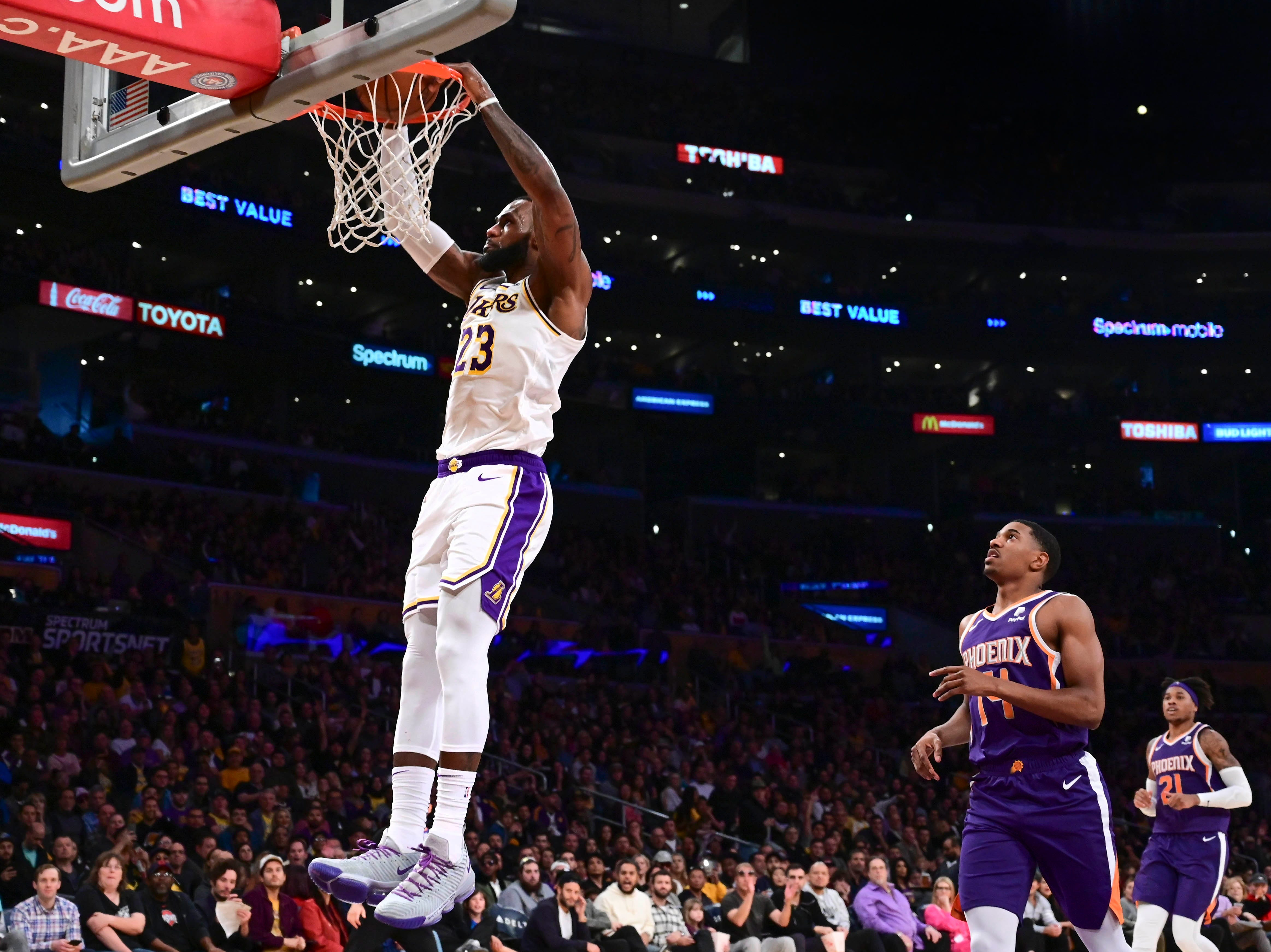 Dec. 2: Los Angeles Lakers forward LeBron James dunks in the third quarter against the Phoenix Suns at Staples Center.