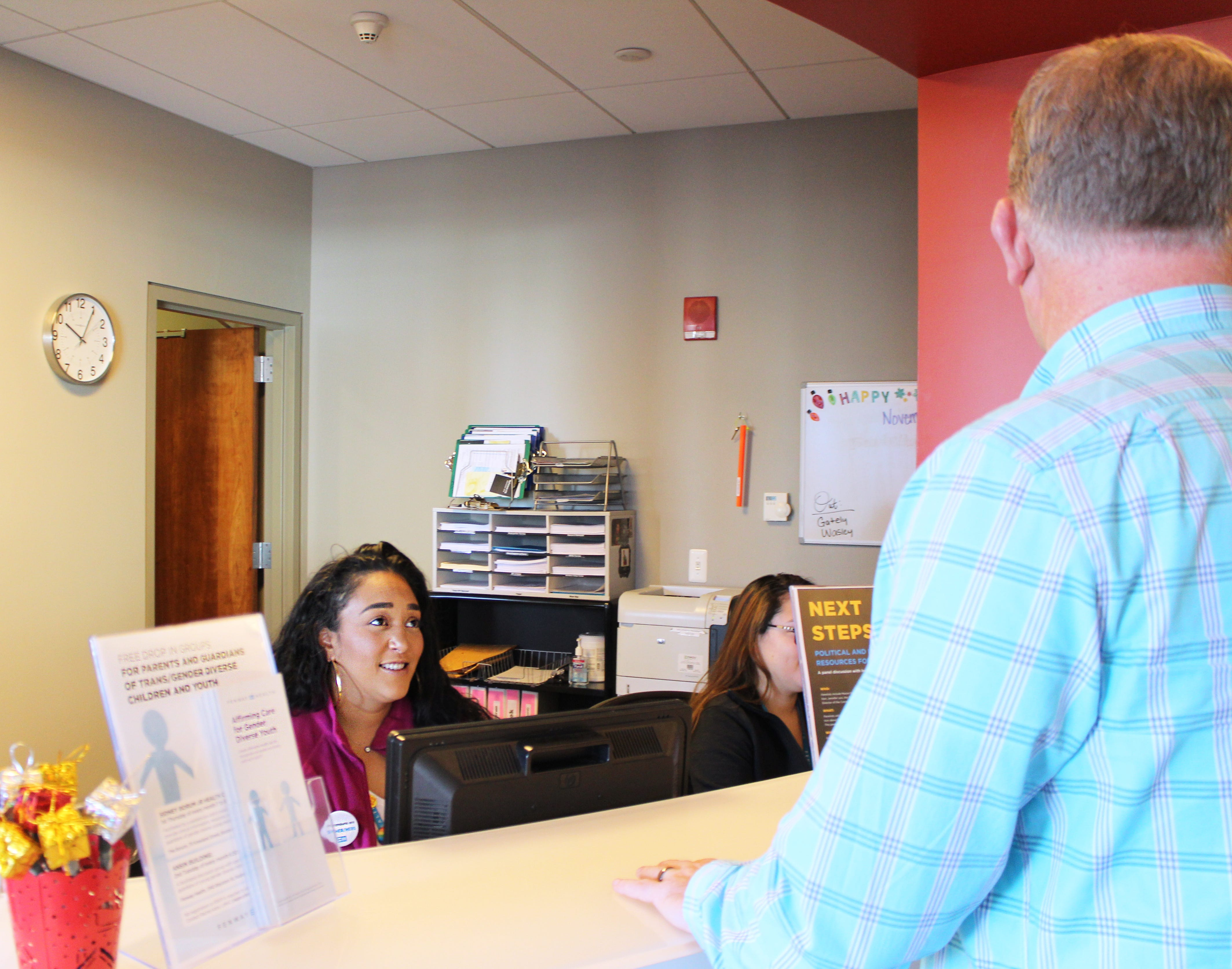 Karen Ruiz checks in a patient at Fenway Health, a Boston community health center that specializes in caring for the lesbian, gay, bisexual and transgender community.