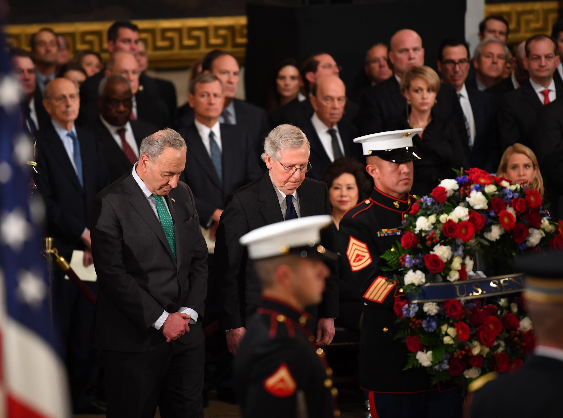 Senate Minority Leader Chuck Schumer, left, and Senate Majority Leader  Mitch McConnel bow their heads as the Senate wreath is presented in the U.S. Capitol Rotunda.