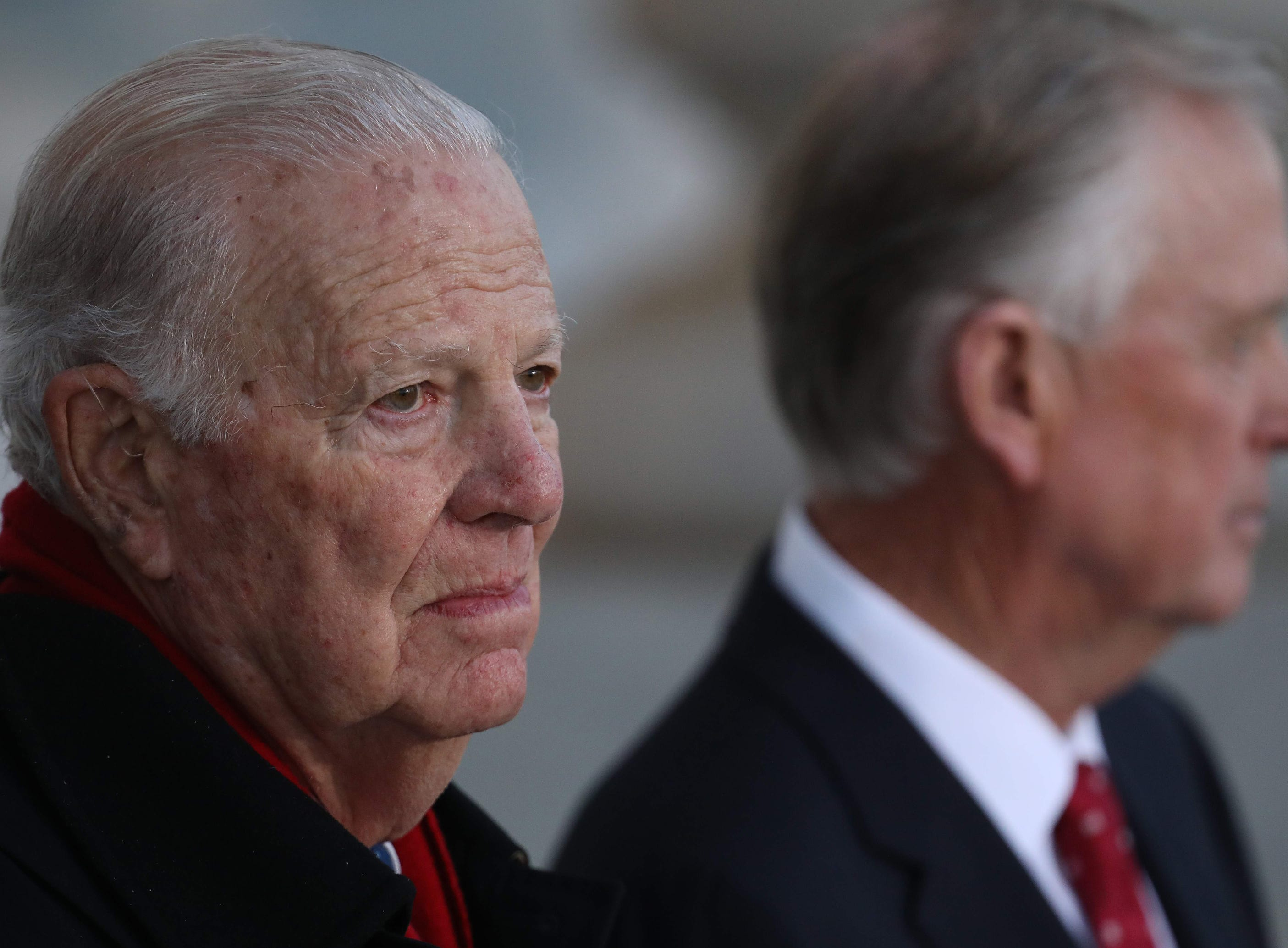 Former Secretary of State James Baker, left,  and former Vice President Dan Quayle await the arrival of the procession carrying the casket of former President George H. W. Bush.  Baker and Bush were close personal friends.