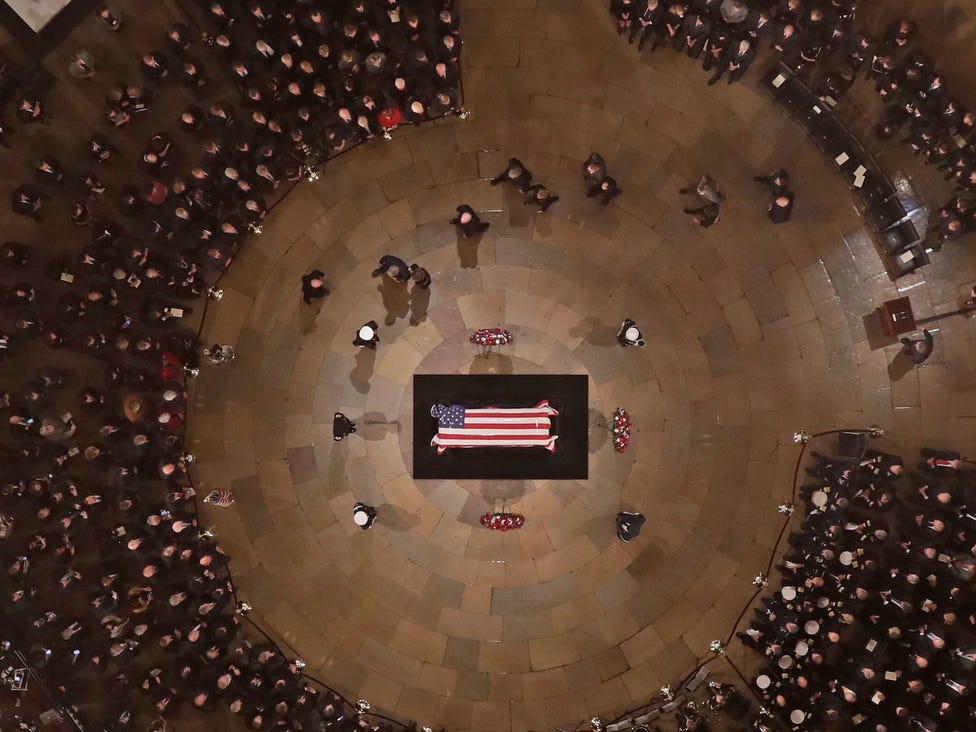 The Bush family walks past as former President George H. W. Bush as he lies in state in the US Capitol Rotunda.