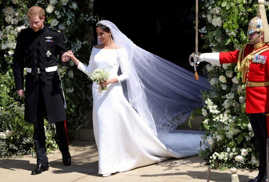 Prince Harry and Meghan Markle scoot away after their marriage ceremony at St. George's Chapel in Windsor Citadel in Windsor, Might maybe 19, 2018.