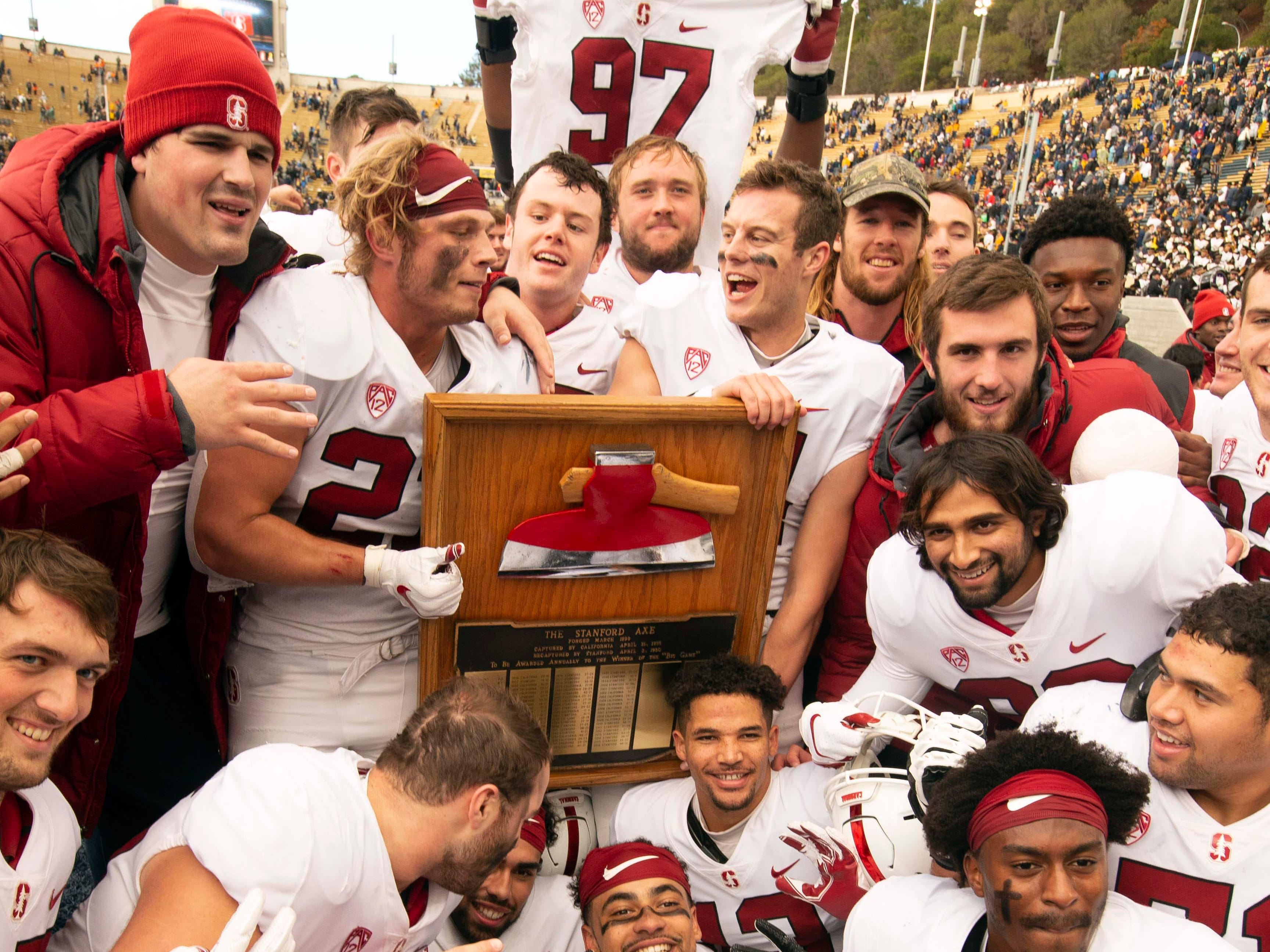 Stanford Axe: Stanford players celebrate a 23-13 victory over California in the 121st Big Game at California Memorial Stadium on Dec. 1.