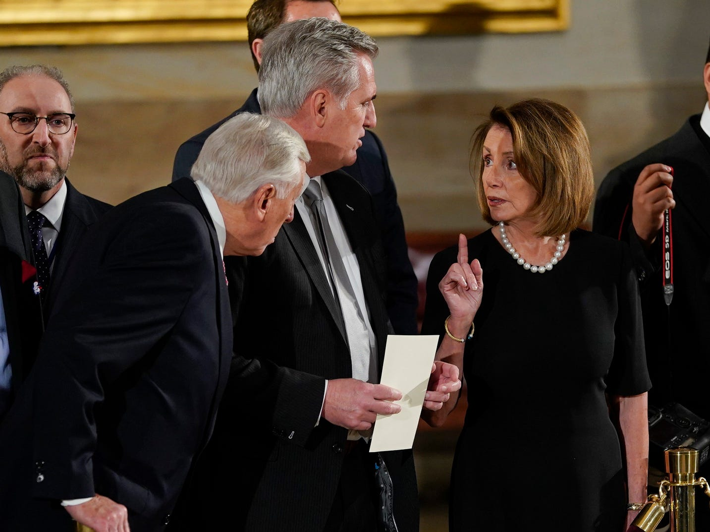 House Minority Leader Nancy Pelosi of California, right, talks with House Majority Leader Kevin McCarthy of California, center, and House Minority Whip Steny Hoyer, D-Md., left, as they arrive to attend services for former US President George H.W. Bush.
