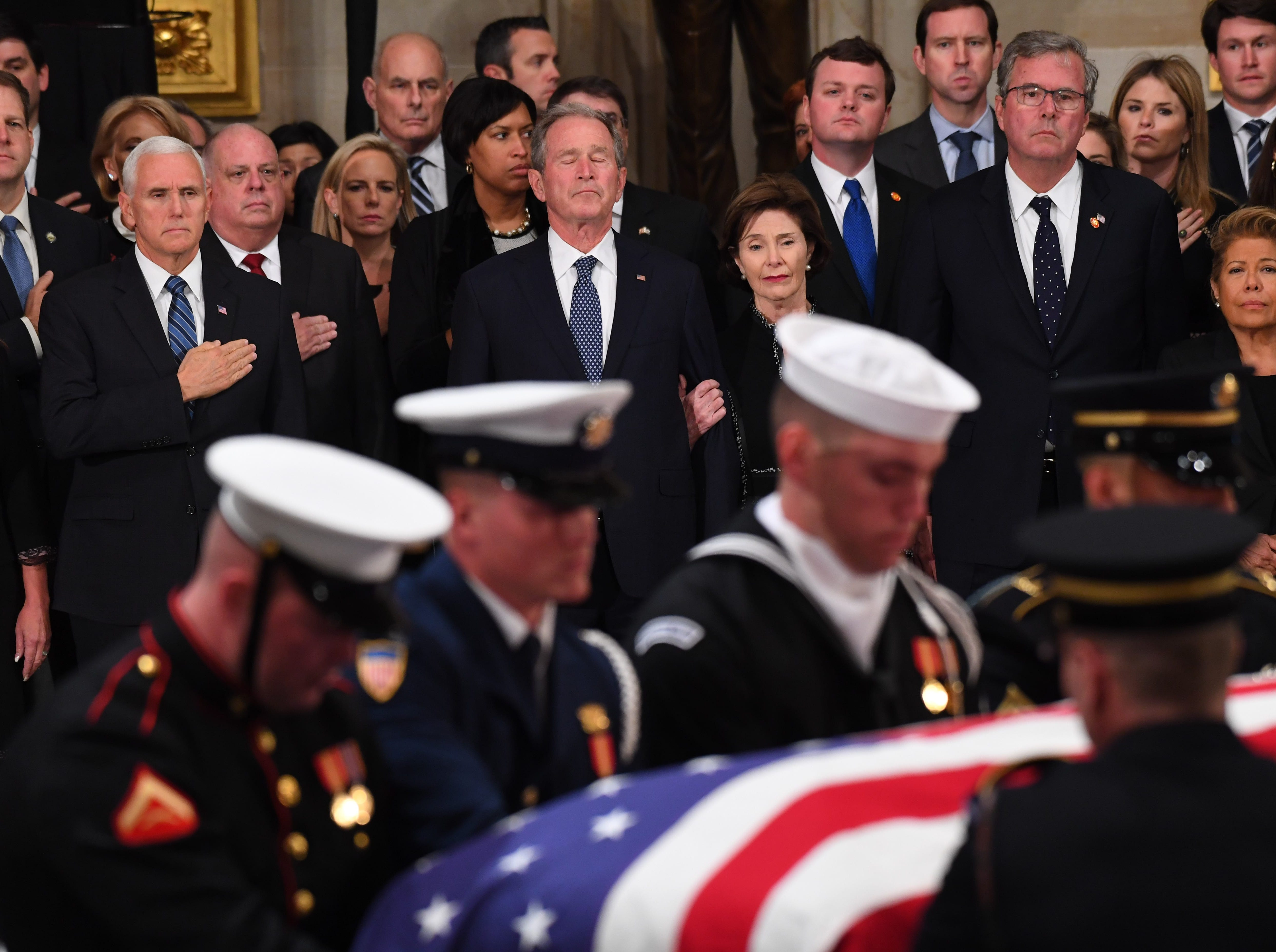 Members of the Bush family, including President George W. Bush as the casket containing President George H.W. Bush is brought to lie in state at the U.S. Capitol Rotunda.