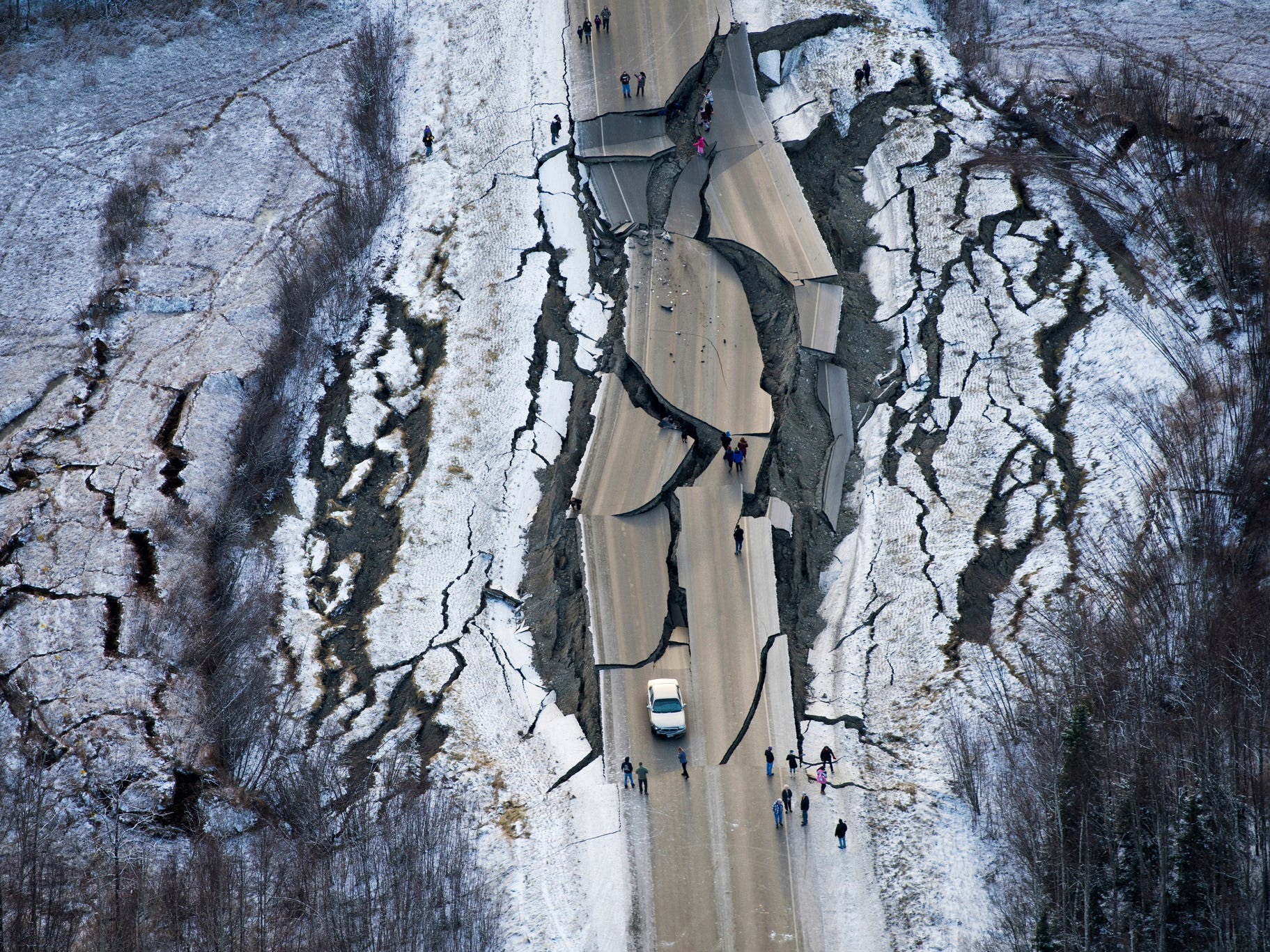 This aerial photo shows damage on Vine Road, south of Wasilla, Alaska, after earthquakes Friday, Nov. 30, 2018. Back-to-back earthquakes measuring 7.0 and 5.7 shattered highways and rocked buildings Friday in Anchorage and the surrounding area, sending people running into the streets and briefly triggering a tsunami warning for islands and coastal areas south of the city.