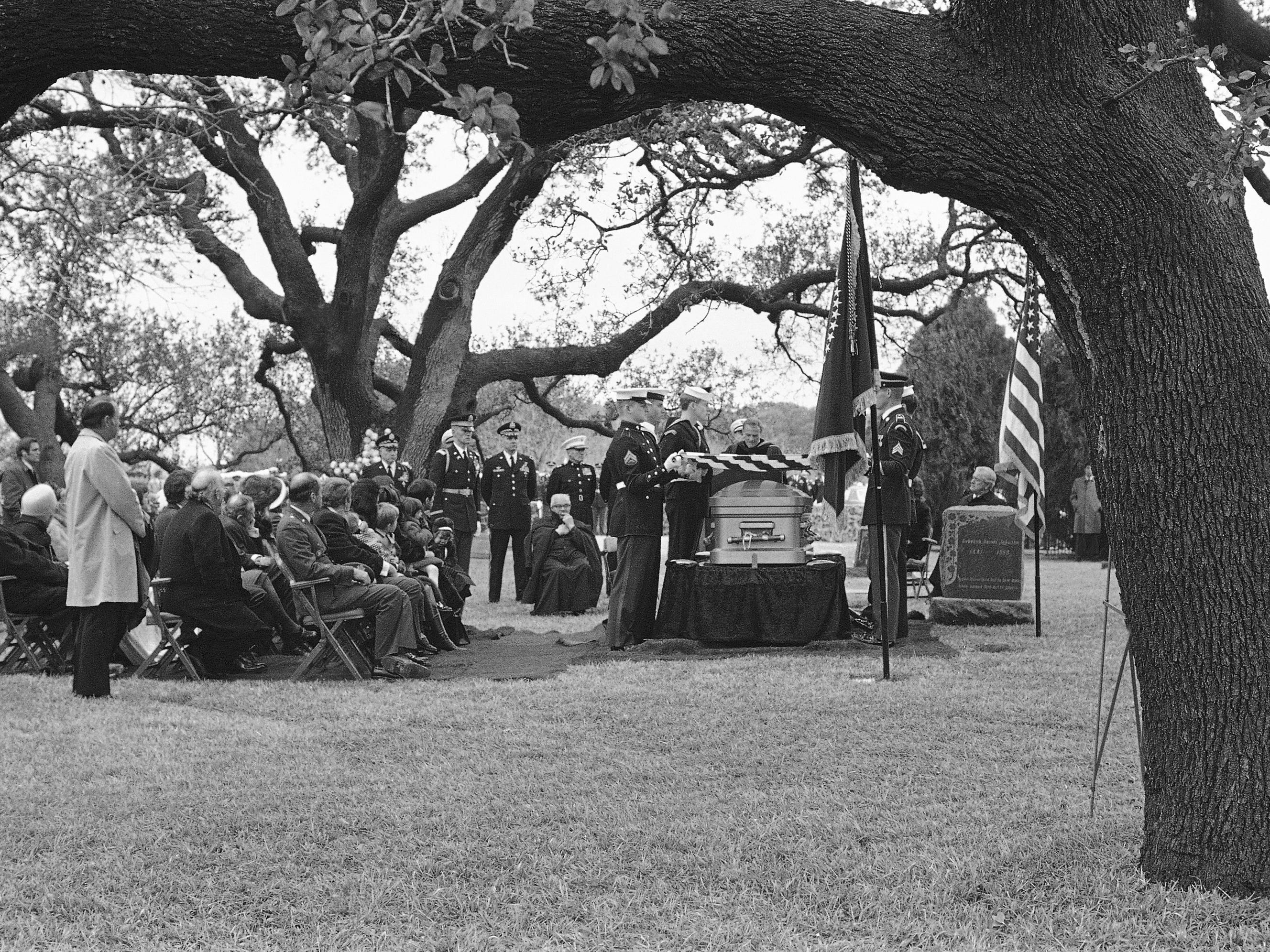 Rev. Billy Graham delivers the eulogy at the funeral of former President Lyndon B. Johnson at the family cemetery on the LBJ ranch in Stonewall, Texas, on Jan. 25, 1973.