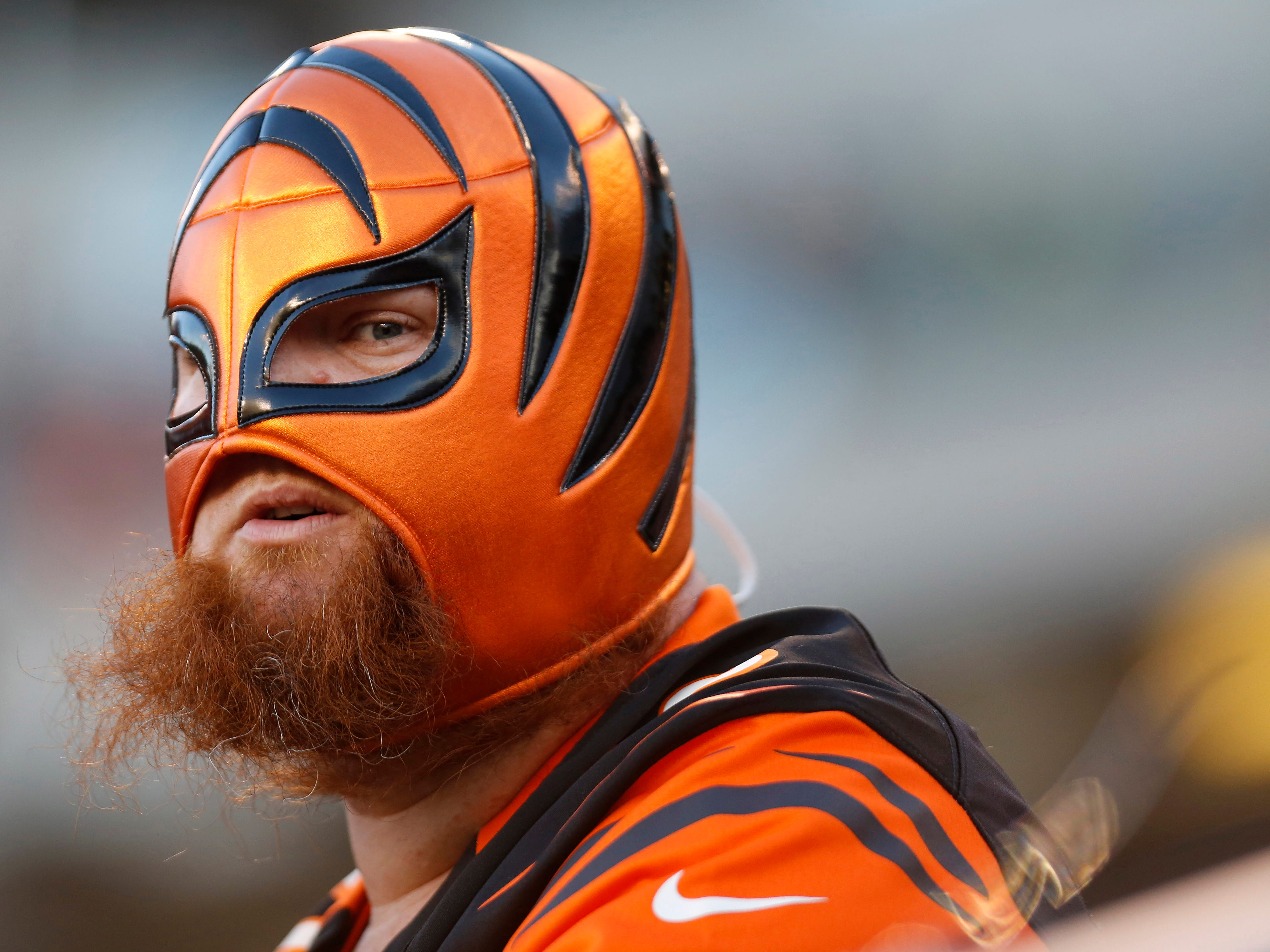A Cincinnati Bengals fan watches late in the second half against the Denver Broncos at Paul Brown Stadium.
