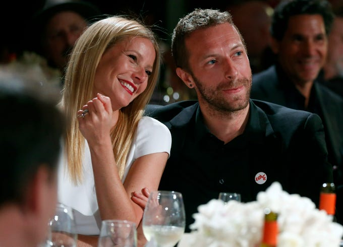 FILE - This Jan. 11, 2014 file photo shows actress Gwyneth Paltrow, left, and her husband, singer Chris Martin at the 3rd Annual Sean Penn & Friends Help Haiti Home Gala in Beverly Hills, Calif. Paltrow filed for divorce on Monday April 20, 2015, in Los Angeles, citing irreconcilable differences and seeks joint physical and legal custody of her  two children with Martin. (Photo by Colin Young-Wolff /Invision/AP, File) ORG XMIT: NYET100
