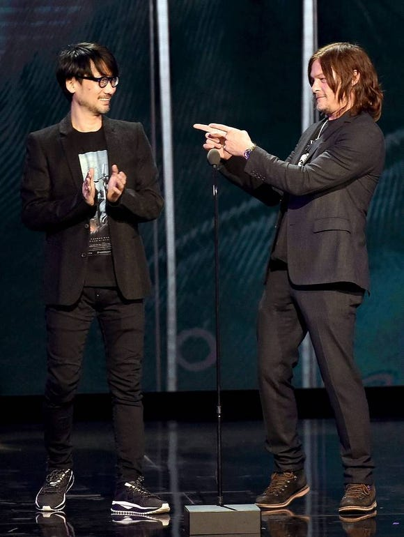 Metal Gear Solid creator Hideo Kojima and Norman Reedus (The Walking Dead) on stage during The Game Awards on Dec. 7, 2017 from the Microsoft Theater in Los Angeles.