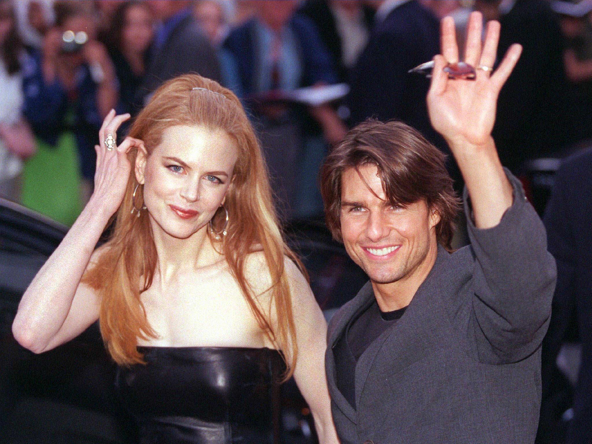 "(FILES): This 04 September 1999 file photo shows US actor Tom Cruise (R) and his wife, Australian actress Nicole Kidman, arriving for the German premier of ""Eyes Wide Shut"", the last work of late US director Stanley Kubrick, at the Cinemaxx cinema in Hamburg, Germany. According to reports 05 February 2001, Cruise and Kidman are divorcing.  AFP PHOTO/DPA/FILES/KAY NIETFELD ORG XMIT: HBG03"