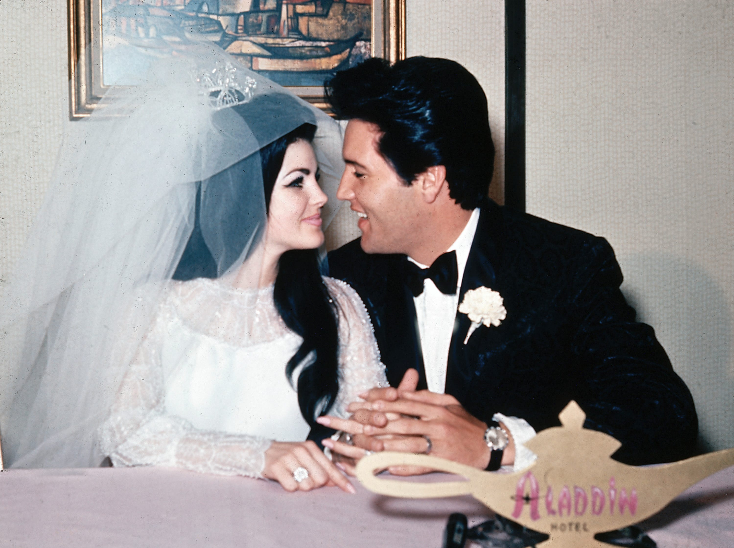 "FILE  - In this May 1, 1967, file photo, singer Elvis Presley and his bride, the former Priscilla Beaulieu, appear at the Aladdin Hotel in Las Vegas, after their wedding. Presley, 32, and Beaulieu, 21, both from Memphis, Tenn., met while he was stationed in Germany with the U.S. Army.  The new Elvis Presley's Graceland Wedding Chapel at the Westgate Resort & Hotel in Las Vegas is scheduled to open on Thursday, April 23, 2015, as part of the new ""Graceland Presents ELVIS: The Exhibition - The Show - The Experience"" in Las Vegas. (AP Photo/File) ORG XMIT: CAET295 [Via MerlinFTP Drop]"