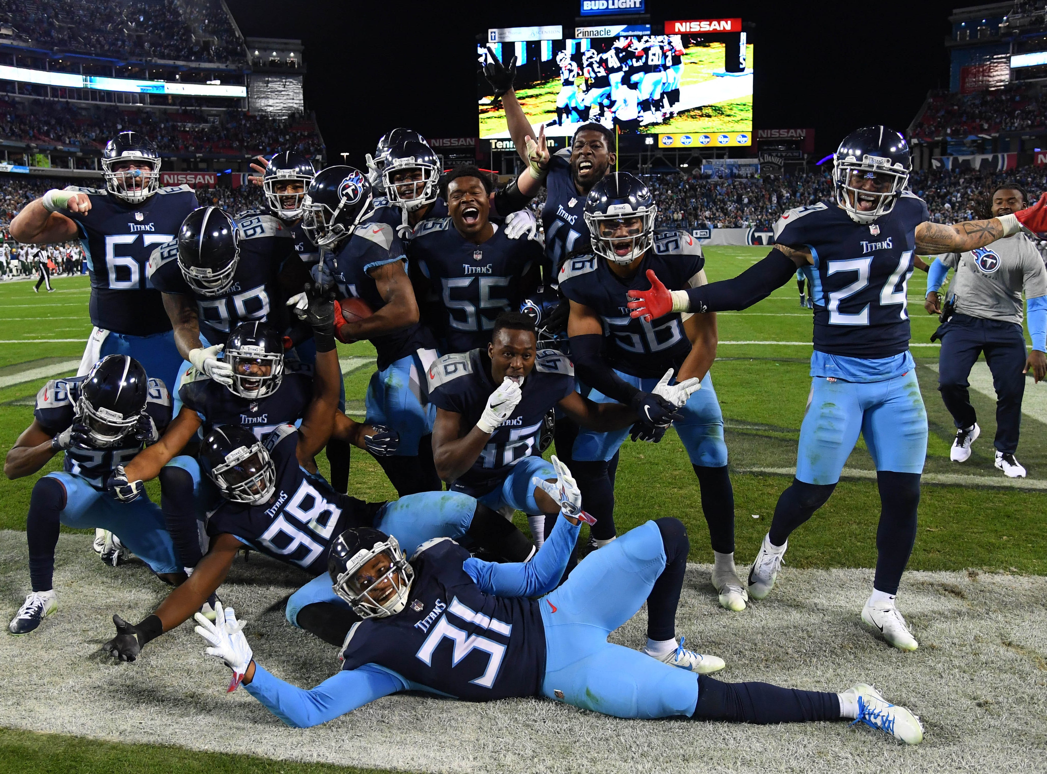 Titans players celebrate after a game-sealing interception by cornerback Malcolm Butler against the Jets.
