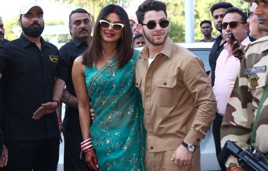 Bollywood actress Priyanka Chopra and Nick Jonas pose for photographs as they leave after their wedding ceremony, in Jodhpur, India, 03 December 2018.