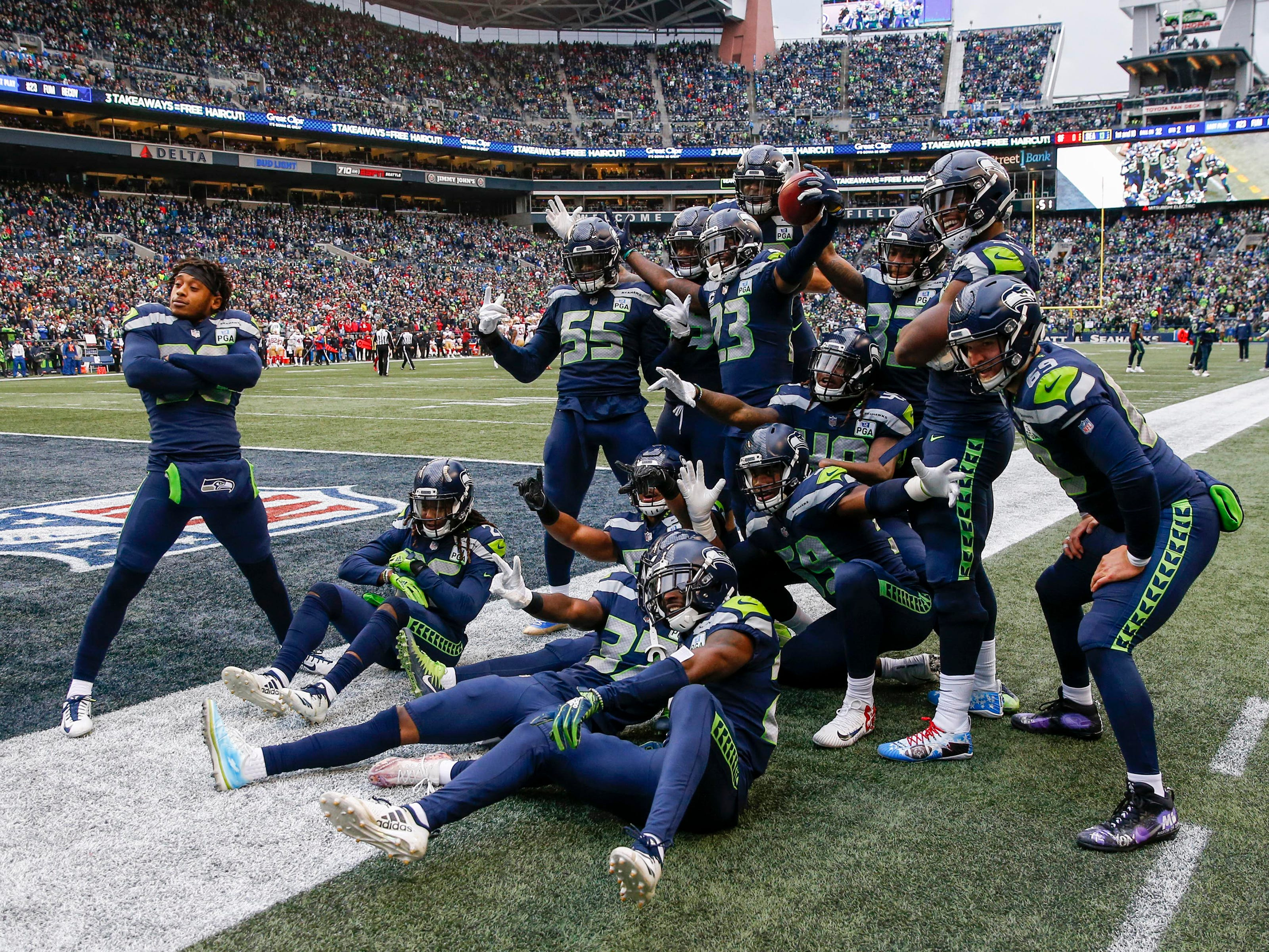 Members of the Seattle Seahawks special teams celebrate after recovering a fumble by the San Francisco 49ers during the second quarter at CenturyLink Field.