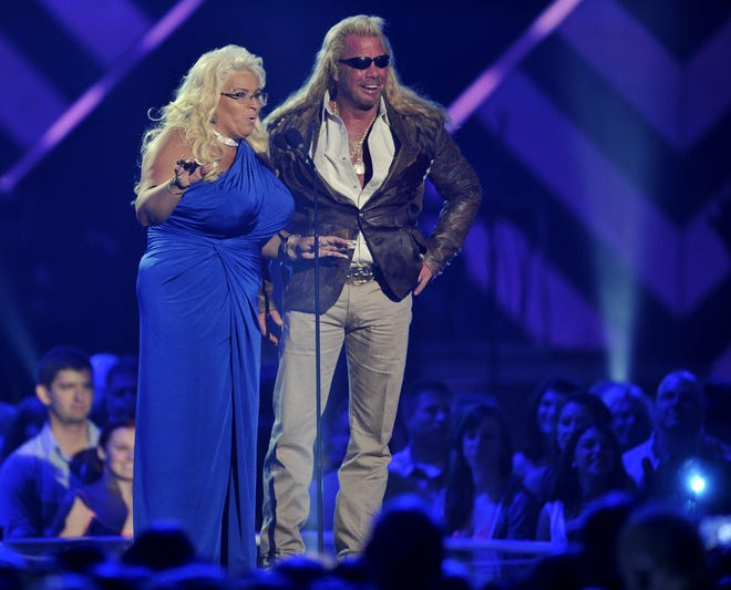 """Duane """"Dog"""" and Beth Chapman, seen here at the 2013 CMA Awards, are back in Colorado after she underwent surgery to remove a tumor from her throat."""