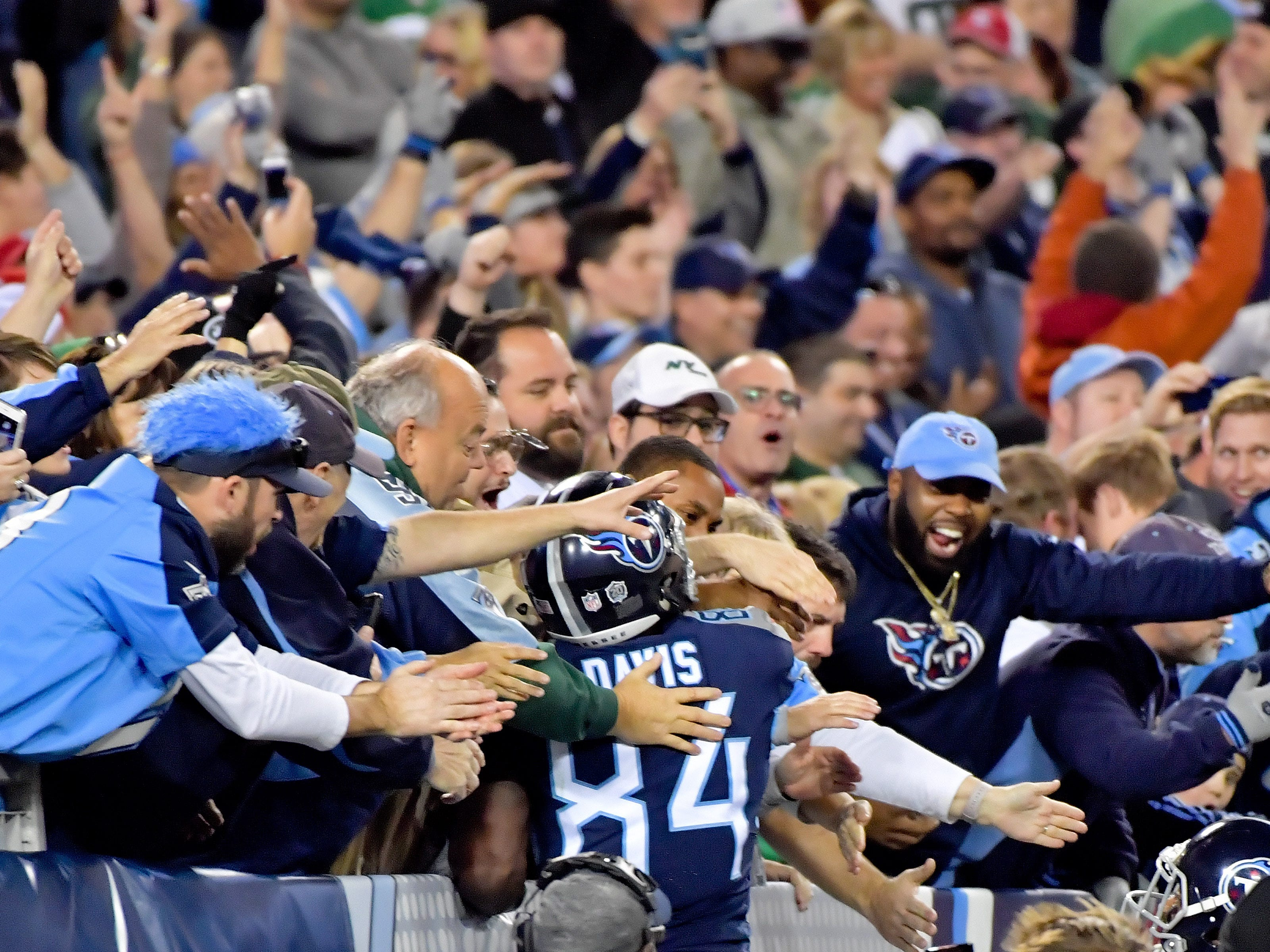 Tennessee Titans wide receiver Corey Davis celebrates with fans after scoring the winning touchdown against the New York Jets during the second half at Nissan Stadium.
