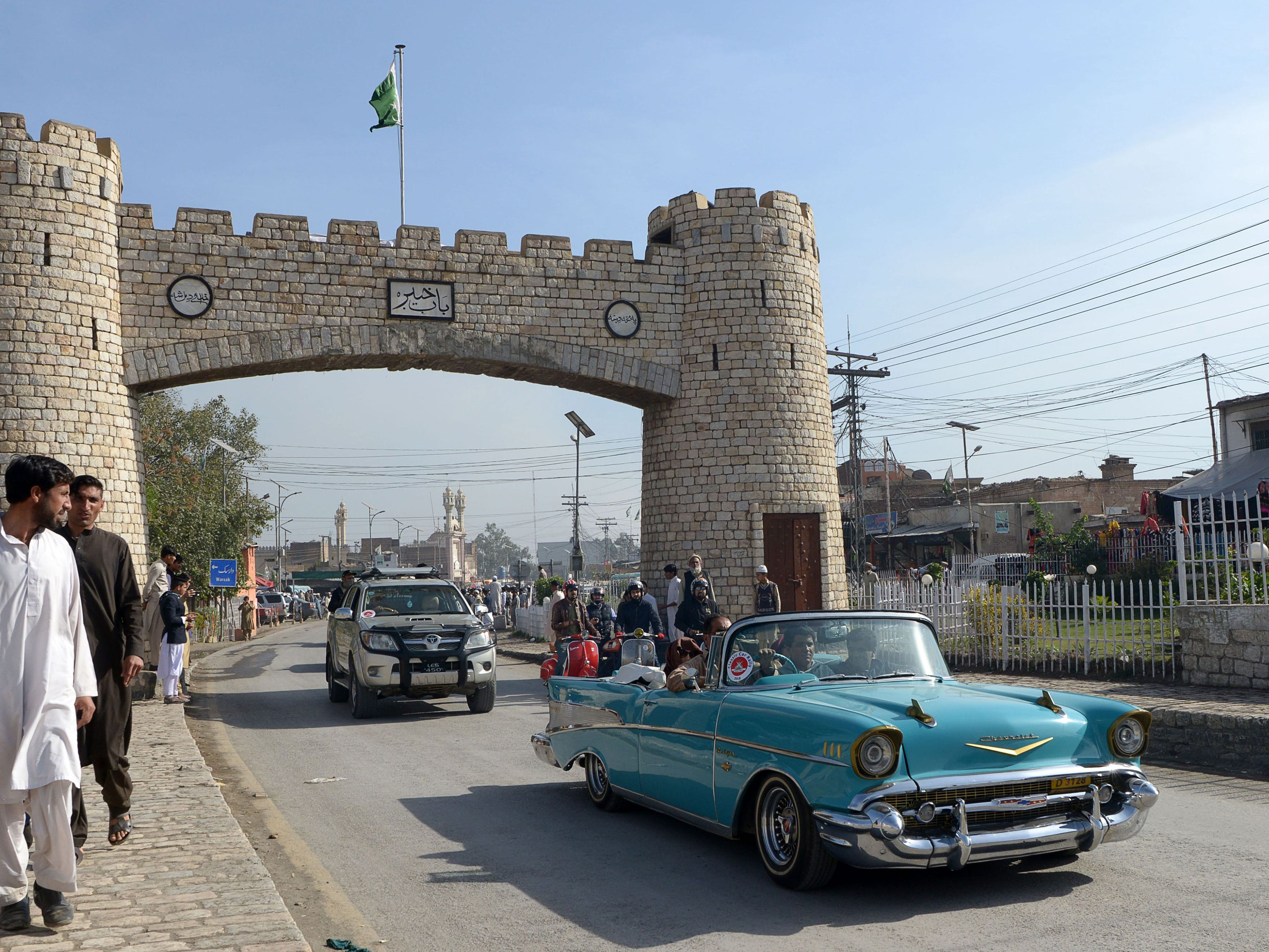 Pakistani people drive vintage cars at the '9th Annual Classic Car Rally 2018' in Landi Kotal, a town in the Khyber Pakhtunkhwa province on November 24, 2018. (Photo by ABDUL MAJEED / AFP)        (Photo credit should read ABDUL MAJEED/AFP/Getty Images)