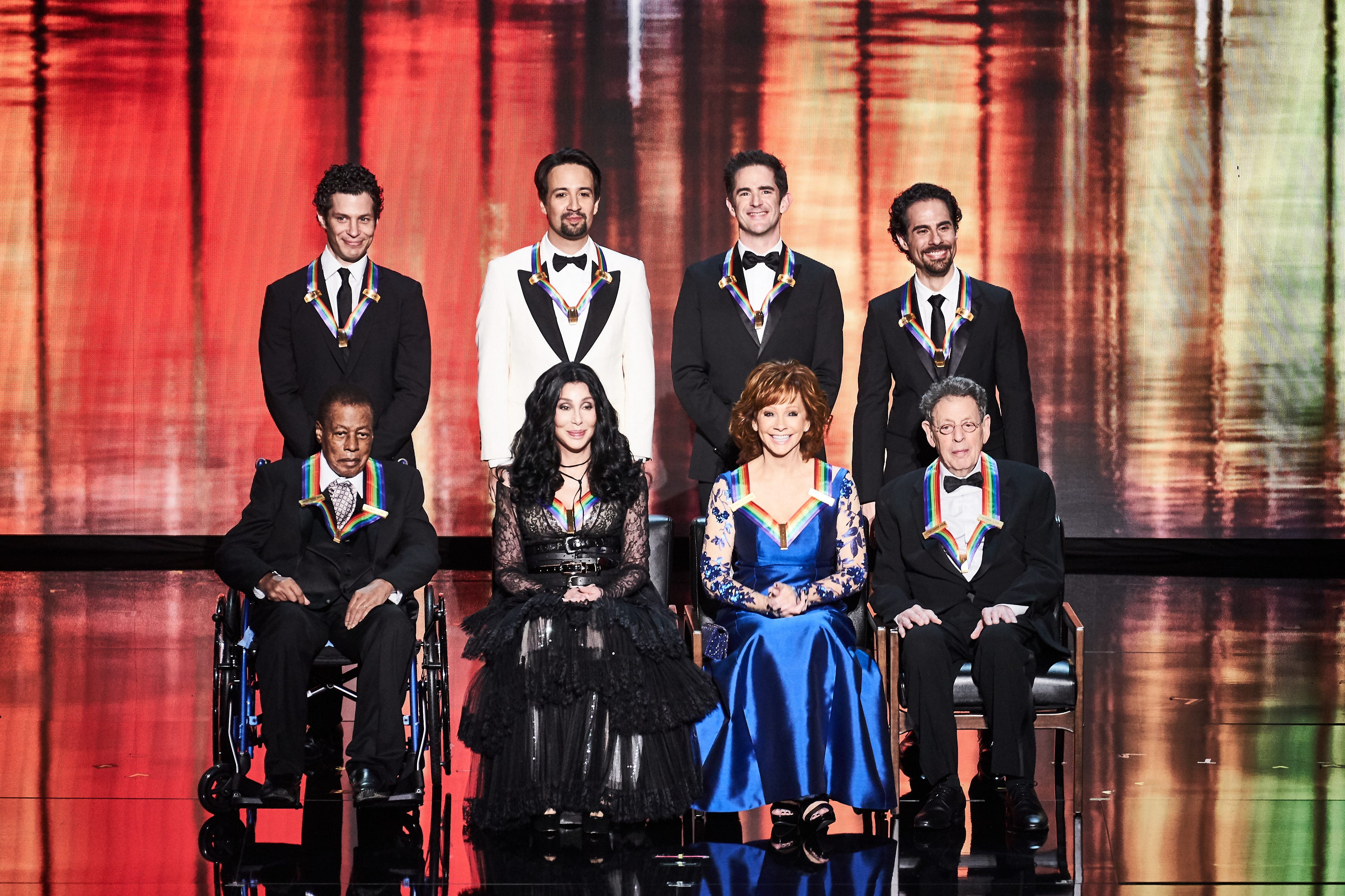 Kennedy Center Honorees for 2018: (Back row, left to right) Thomas Kail, Lin-Manuel Miranda, Andy Blankenbuehler and Alex Lacamoire, (front row, left to right) Wayne Shorter, Cher, Reba McEntire and Philip Glass.