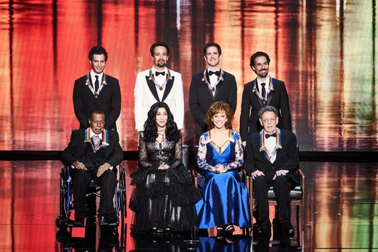 2018 Honorees on the stage Kch 201[ads1]8 Scott Suchman [2018-02] Kennedy Center Honorees for 2018: (back row from left to right) Thomas Kail, Lin Manuel Miranda, Andy Blankenbuehler and Alex Lacamoire, (first row from left to right ) Wayne Shorter, Cher, Reba McEntire and Philip Glass. </span><meta itemprop=