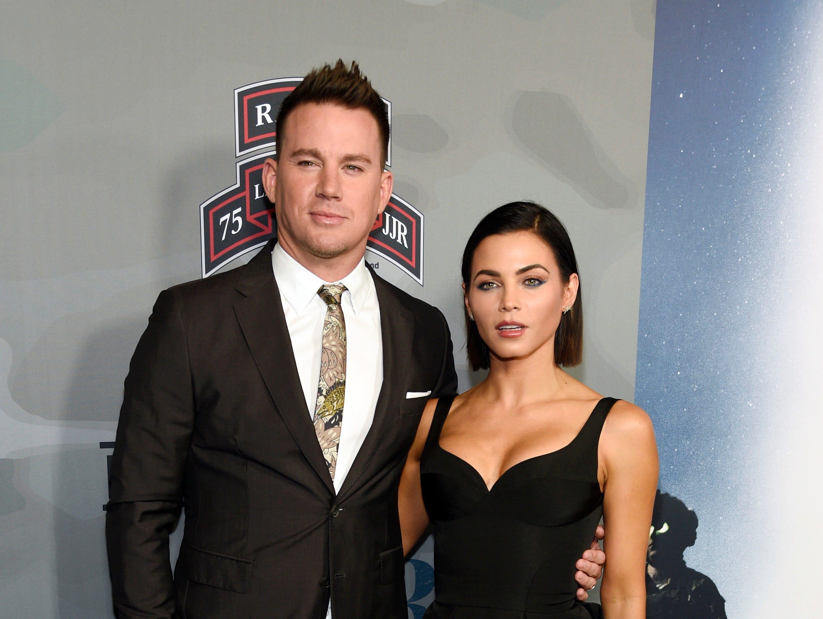 "Channing Tatum, left, executive producer of the HBO documentary film ""War Dog: A Soldier's Best Friend,"" poses with his wife, actress Jenna Dewan Tatum, at the premiere of the film at the Directors Guild of America on Monday, Nov. 6, 2017, in Los Angeles. (Photo by Chris Pizzello/Invision/AP) ORG XMIT: CACP104"