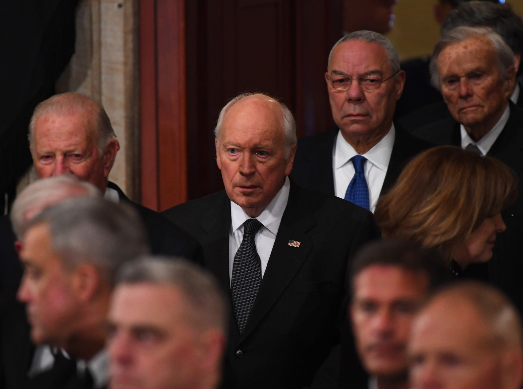 Former Secretary of State James Baker III, left, former Vice President Dick Cheney and former Secretary of State Colin Powell file in to pay their respects to former President George H.W. Bush.