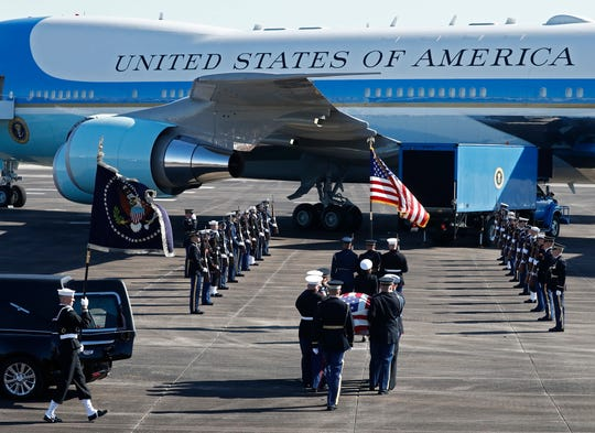 The casket carrying former President George H.W. Bush is moved to Special Air Mission 41 plane during the Departure Ceremony at Ellington Field in Houston, Dec. 3, 2018.