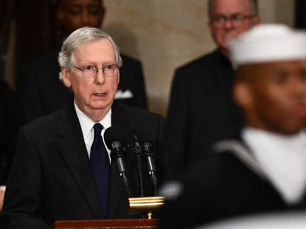 Senator Mitch McConnell (R-KY) speaks as former President George H.W. Bush lies in state in the U.S. Capitol Rotunda. A WWII combat veteran, Bush served as a member of Congress from Texas, ambassador to the United Nations, director of the CIA, vice president and 41st president of the United States.
