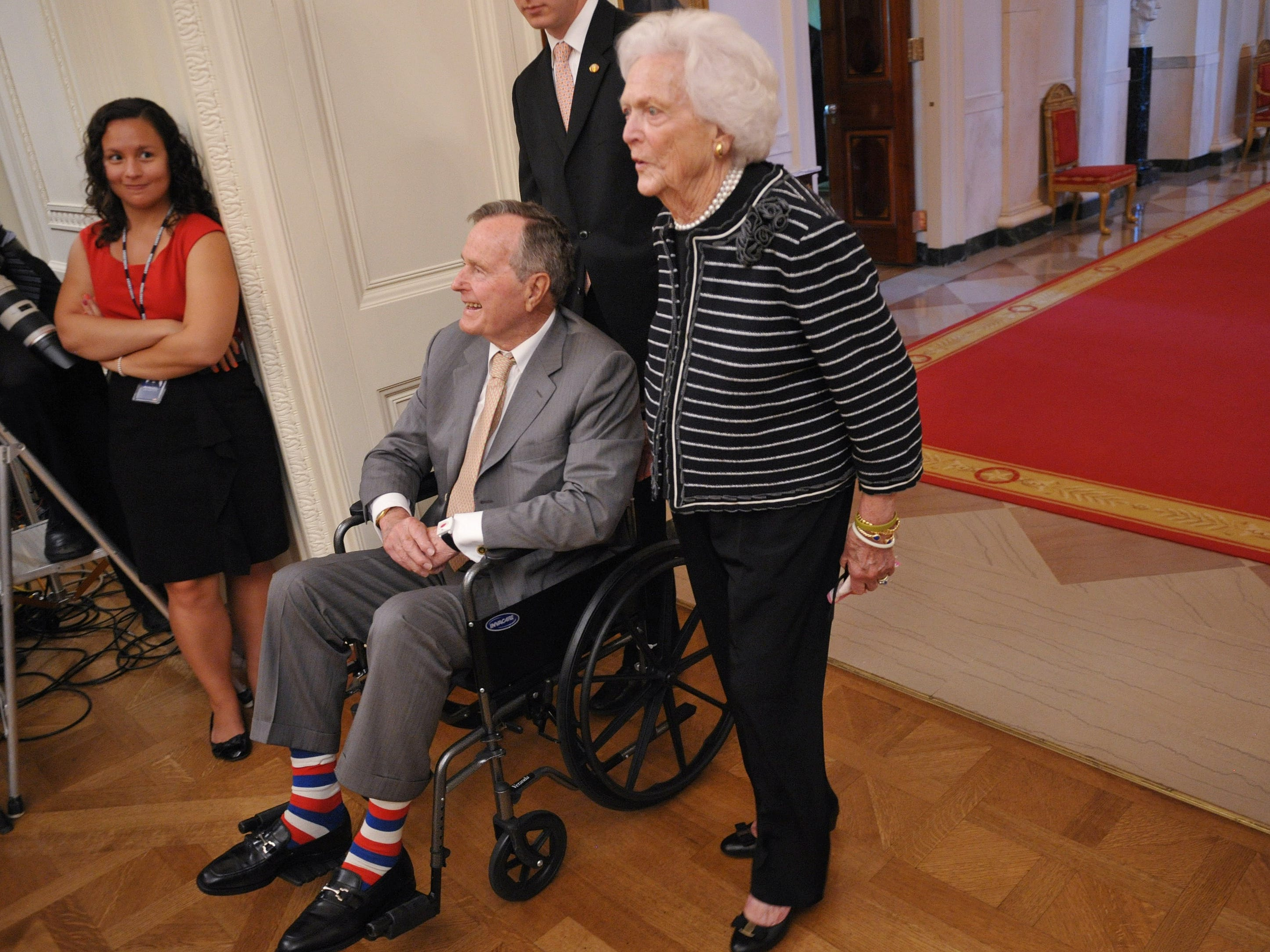 US President George H.W. Bush and his wife Barbara arrive for the portrait unveiling of former US president George W. Bush and his wife Laura Bush  May 31, 2012 in the East Room of the White House in Washington, DC.  AFP PHOTO/Mandel NGAN (Photo by MANDEL NGAN / AFP)        (Photo credit should read MANDEL NGAN/AFP/Getty Images)