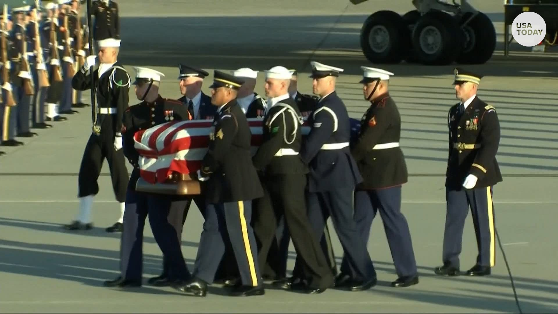 George H W  Bush's remains arrive at JBA for final farewell
