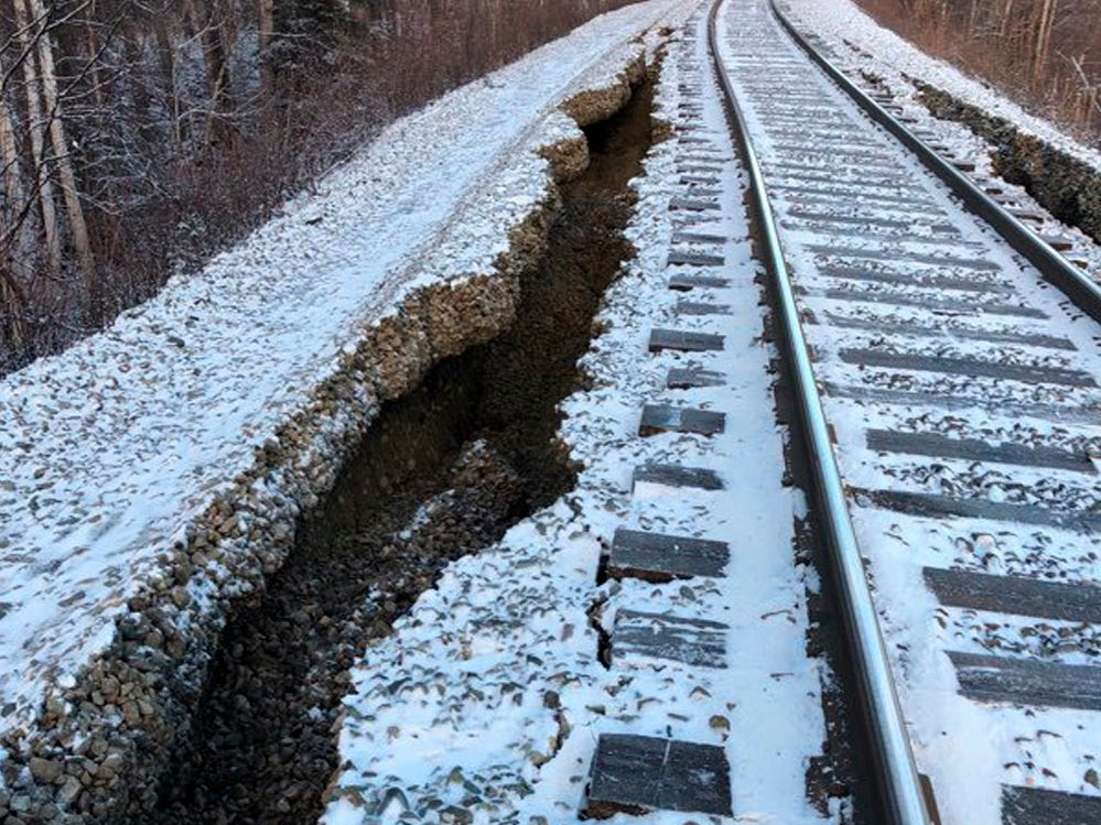This Friday, Nov. 30, 2018 photo provided by Alaska Railroad Corp. shows damage from a magnitude 7.0 earthquake by Nancy Lake, near Willow, Alaska. The railroad will use heavy equipment to repair the damage before it can resume train traffic between Anchorage and Fairbanks, Alaska's two largest cities.