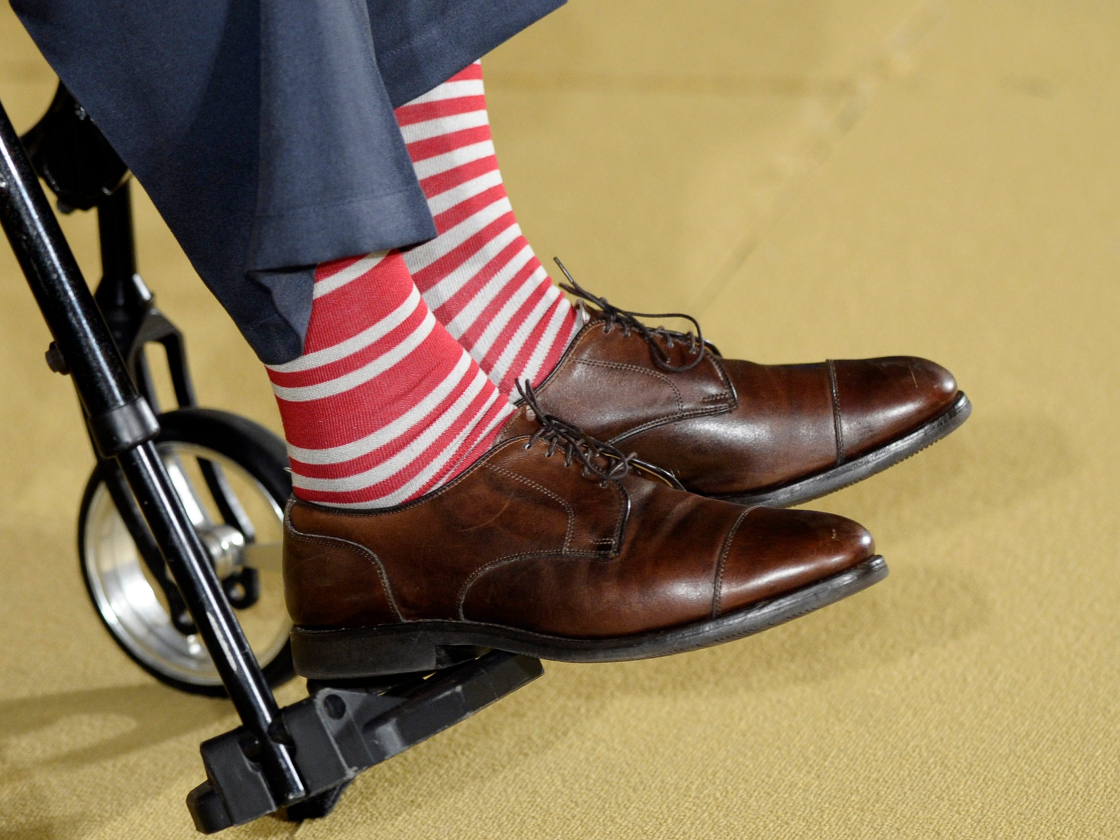 "Former President George H. W. Bush, in a pair of red and white socks, participates in an award ceremony with President Barack Obama for the 5,000th Daily Point of Light Award ceremony in the East Room of the White House of the White House in Washington, Monday, July 15, 2013. Obama welcomed Bush to the White House in a salute to public service and to the drive for volunteerism that the 41st president inspired with his ""thousand points of light"" initiative more than two decades ago.  (AP Photo/Susan Walsh) ORG XMIT: DCSW105"