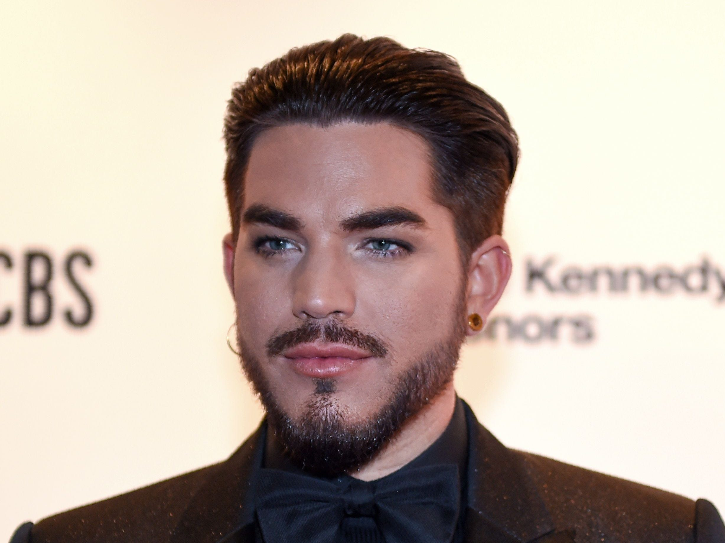 Singer-songwriter Adam Lambert arrives at the 41st Annual Kennedy Center Honors in Washington, DC, on December 2, 2018. - The 2018 honorees are: singer and actress Cher; composer and pianist Philip Glass; Country music entertainer Reba McEntire; and jazz saxophonist and composer Wayne Shorter. This year, the co-creators of Hamilton, writer and actor Lin-Manuel Miranda, director Thomas Kail, choreographer Andy Blankenbuehler, and music director Alex Lacamoire will receive a unique Kennedy Center Honors as trailblazing creators of a transformative work that defies category. (Photo by ROBERTO SCHMIDT / AFP)ROBERTO SCHMIDT/AFP/Getty Images ORIG FILE ID: AFP_1BA8YT