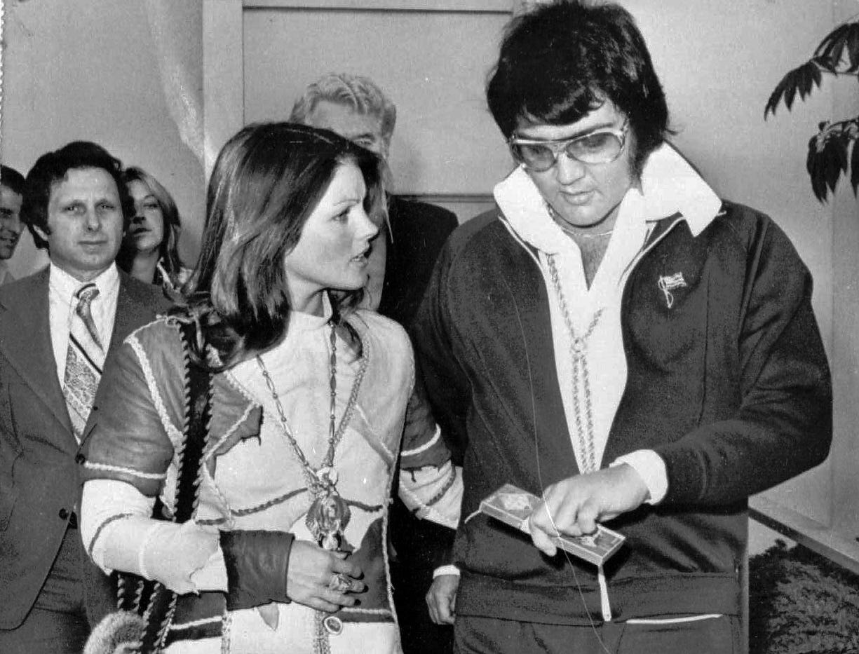 Singer Elvis Presley and wife, Priscilla, 26, leave Superior Court in Santa Monica, Calif. on Oct.10,1973 after he was granted a divorce on grounds of irreconcilable difference. The six year marriage ended with a modified property settlement involving $1.5 million.  (AP Photo) ORG XMIT: NY926 [Via MerlinFTP Drop]