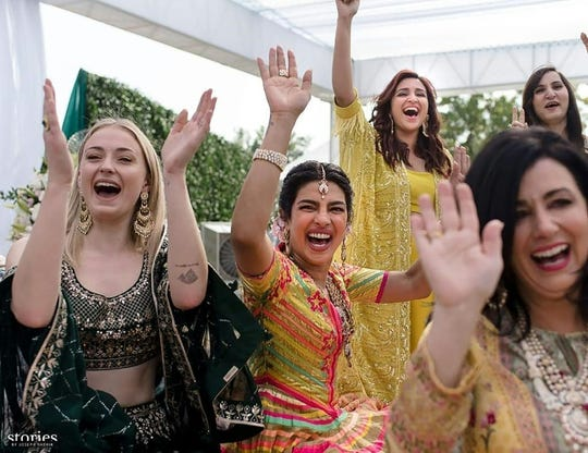 "Future sisters-in-law: Priyanka Chopra, center, celebrates at her second wedding ceremony with 'Game of Thrones"" star Sophie Turner (left), who is  engaged to the second Jonas brother, Joe."