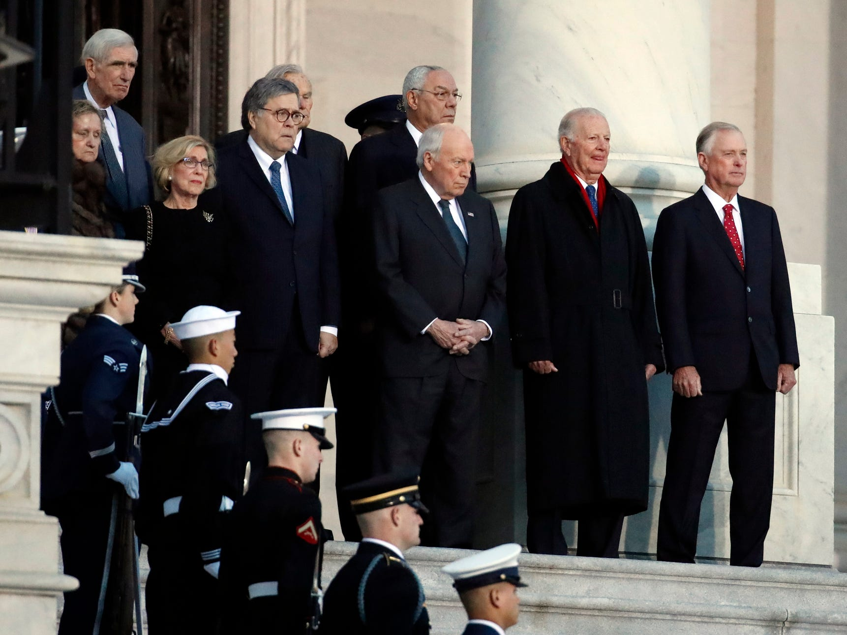 From right, former US Vice President Dan Quayle, James A. Baker III, former Vice President Dick Cheney, former Secretary of State Colin Powell and other wait for the flag-draped casket of former President George H.W. Bush to arrive to lie in state in the rotunda of the U.S. Capitol.
