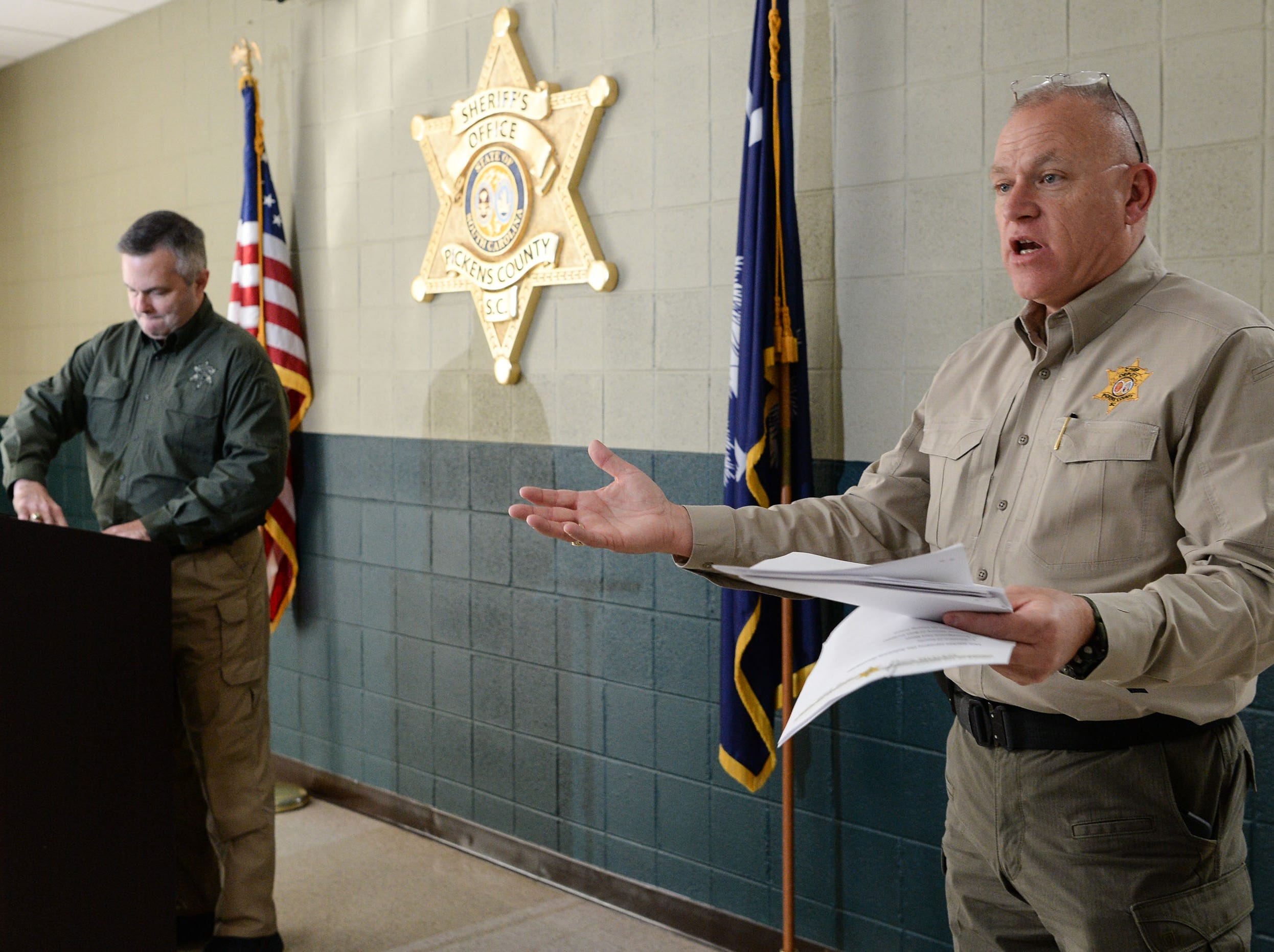 Pickens County Sheriff Office Chief Deputy Creed Has he, right, speaks as Sheriff Rick Clark gets ready to speak to media about two inmates who escaped from the Pickens County Detention Center early Tuesday morning.