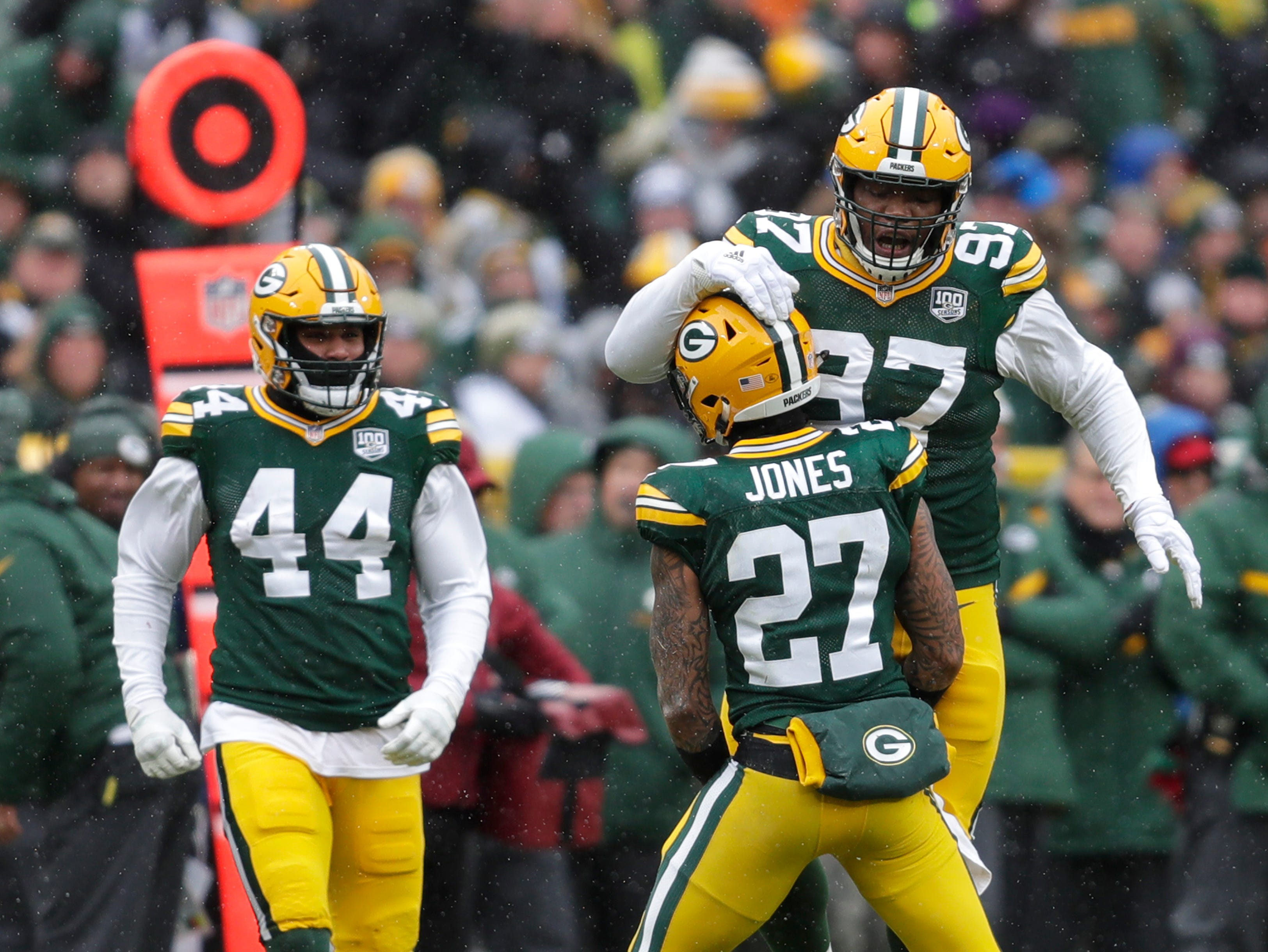 Green Bay Packers defensive back Josh Jones (27) celebrates getting a sack against the Arizona Cardinals with inside linebacker Antonio Morrison (44) and nose tackle Kenny Clark (97) Sunday, December 2, 2018, at Lambeau Field in Green Bay, Wis. 