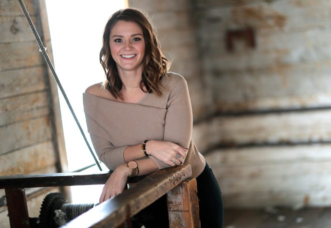 Nadine Machkovech, one of the leaders of the youth group Rise Together, is in recovery from drug addiction and building a life centered on self care and service. She is seen in this portrait Nov. 19 in Appleton.