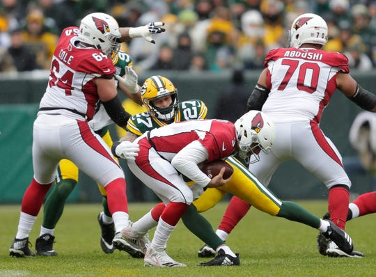 Packers defensive back Josh Jones sacks Cardinals quarterback Josh Rosen in the first quarter Dec. 2 at Lambeau Field in Green Bay, Wis.