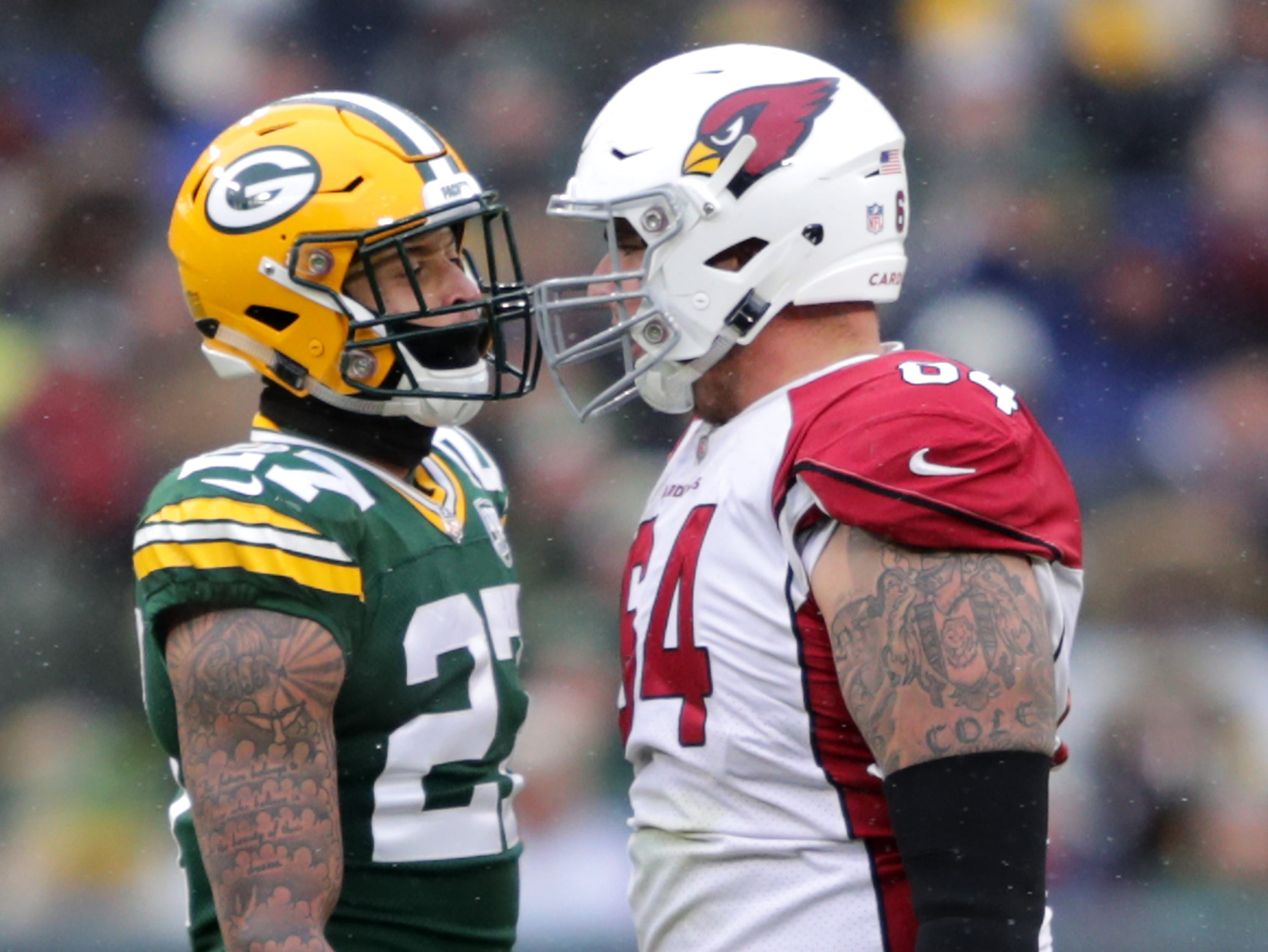 Green Bay Packers defensive back Josh Jones against Arizona Cardinals center Mason Cole during their football game on Sunday, December 2, 2018, at Lambeau Field in Green Bay, Wis. Arizona defeated Green Bay 20 to 17.