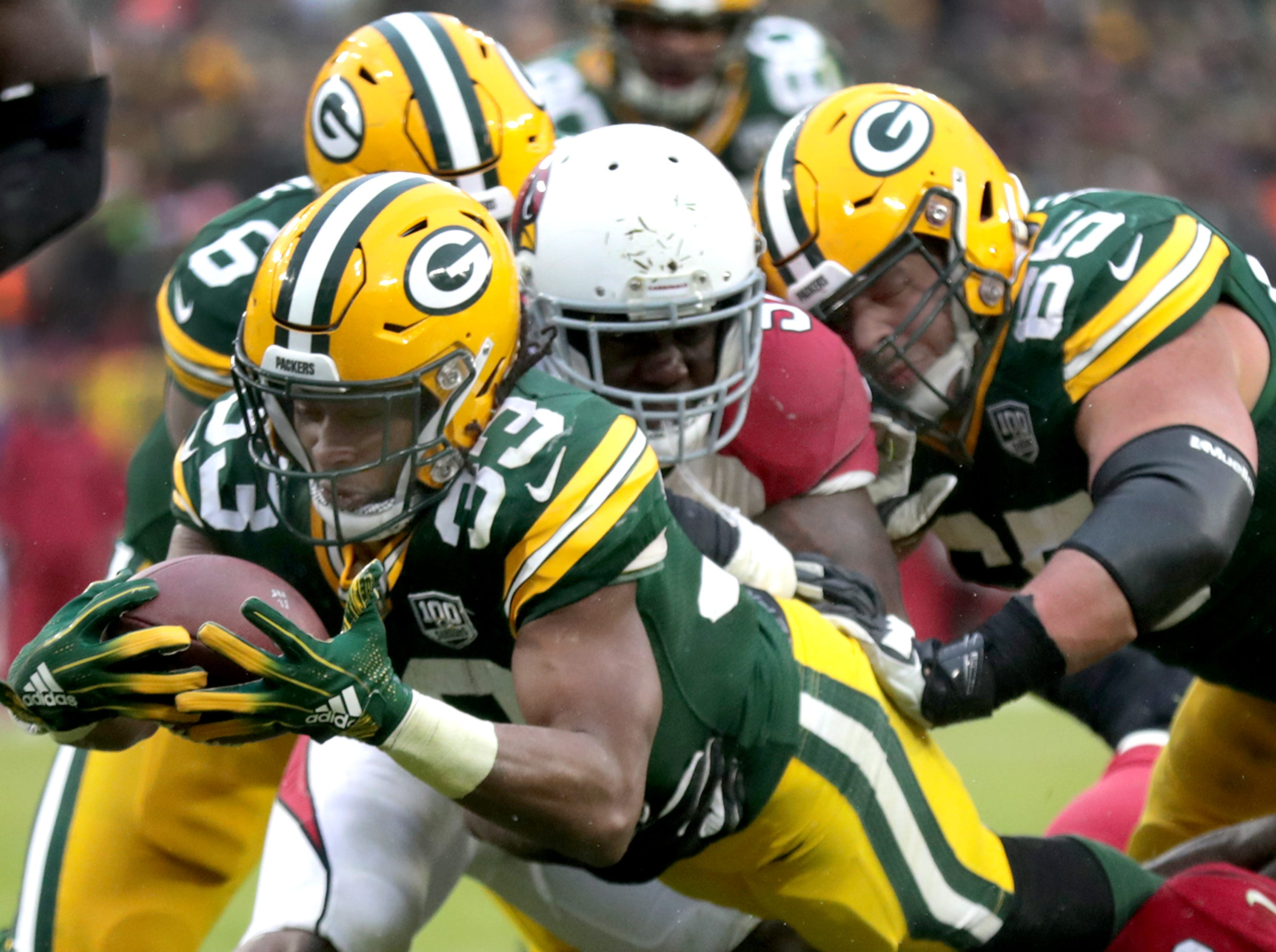 Green Bay Packers running back Aaron Jones rushes for a late fourth quarter touchdown, evening the score up at 17 each, against the Arizona Cardinals during their football game on Sunday, December 2, 2018, at Lambeau Field in Green Bay, Wis. Arizona defeated Green Bay 20 to 17.