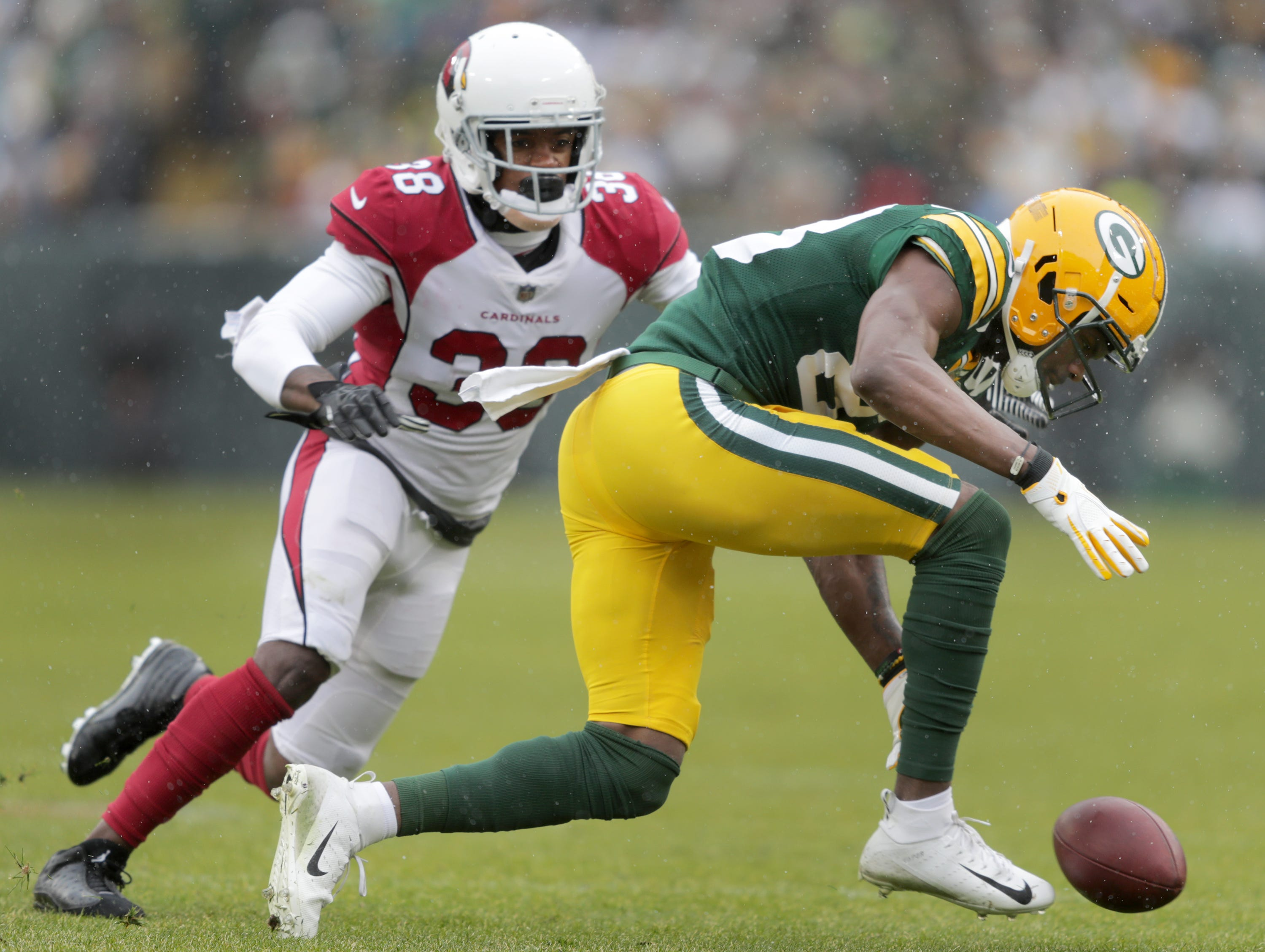 Green Bay Packers wide receiver Marquez Valdes-Scantling agfainst Arizona Cardinals defensive back David Amerson during their football game on Sunday, December 2, 2018, at Lambeau Field in Green Bay, Wis.