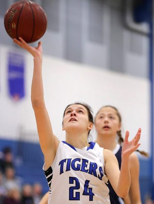 Wrightstown's Ella Diny goes for a layup during a game against Little Chute on Nov. 20 in Wrightstown.