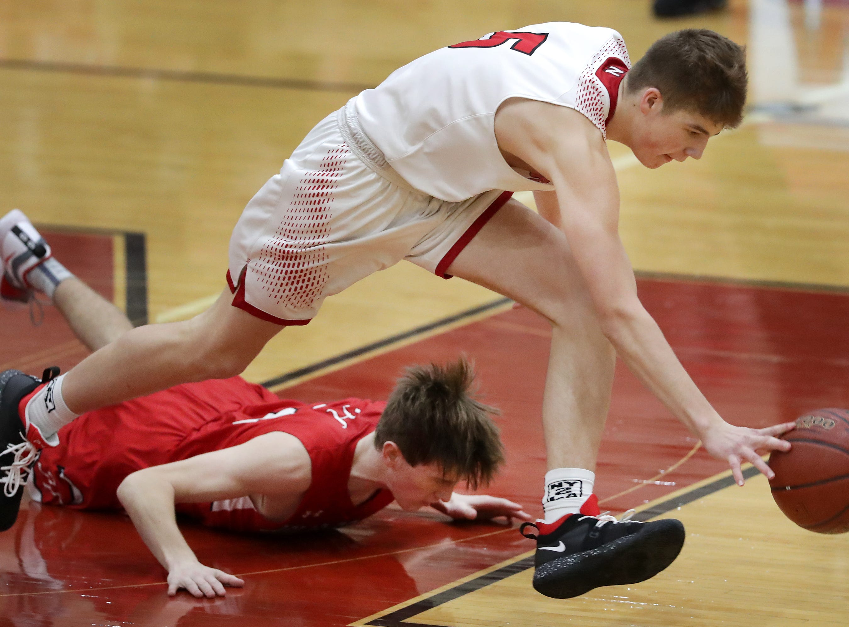 Neenah High School's #5 Max Klesmit against Hortonville High School's #2 Parker Lawrence during their Fox Valley Association boys basketball game on Friday, November 30, 2018, in Neenah, Wis. Neenah defeated Hortonville 71 to 67 in overtime.