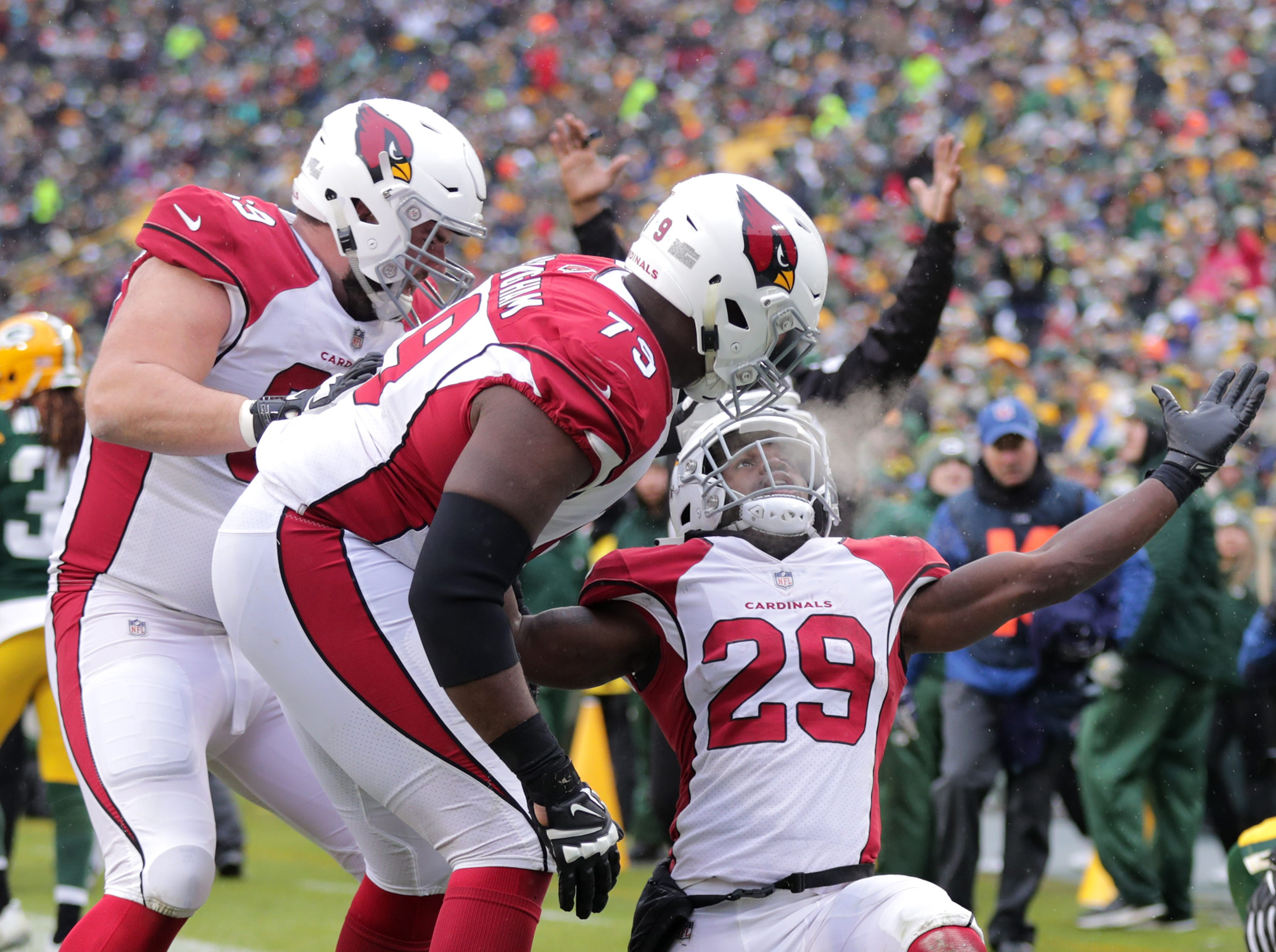 Arizona Cardinals running back Chase Edmonds celebrates a third quarter touchdown against Green Bay Packers inside linebacker Blake Martinez and cornerback Josh Jackson during their football game on Sunday, December 2, 2018, at Lambeau Field in Green Bay, Wis.